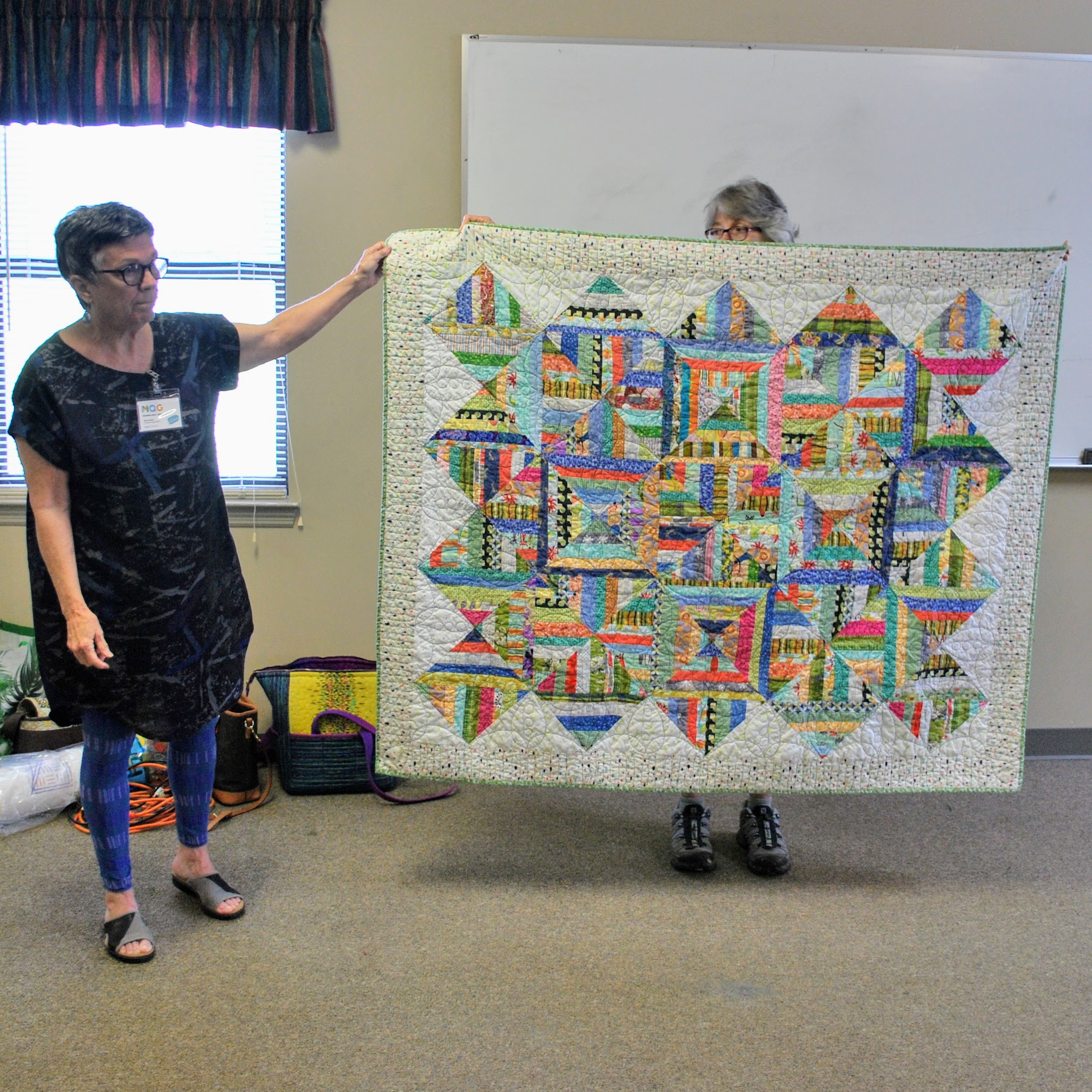 Scrappy strip quilt by Mary Keasler (left)