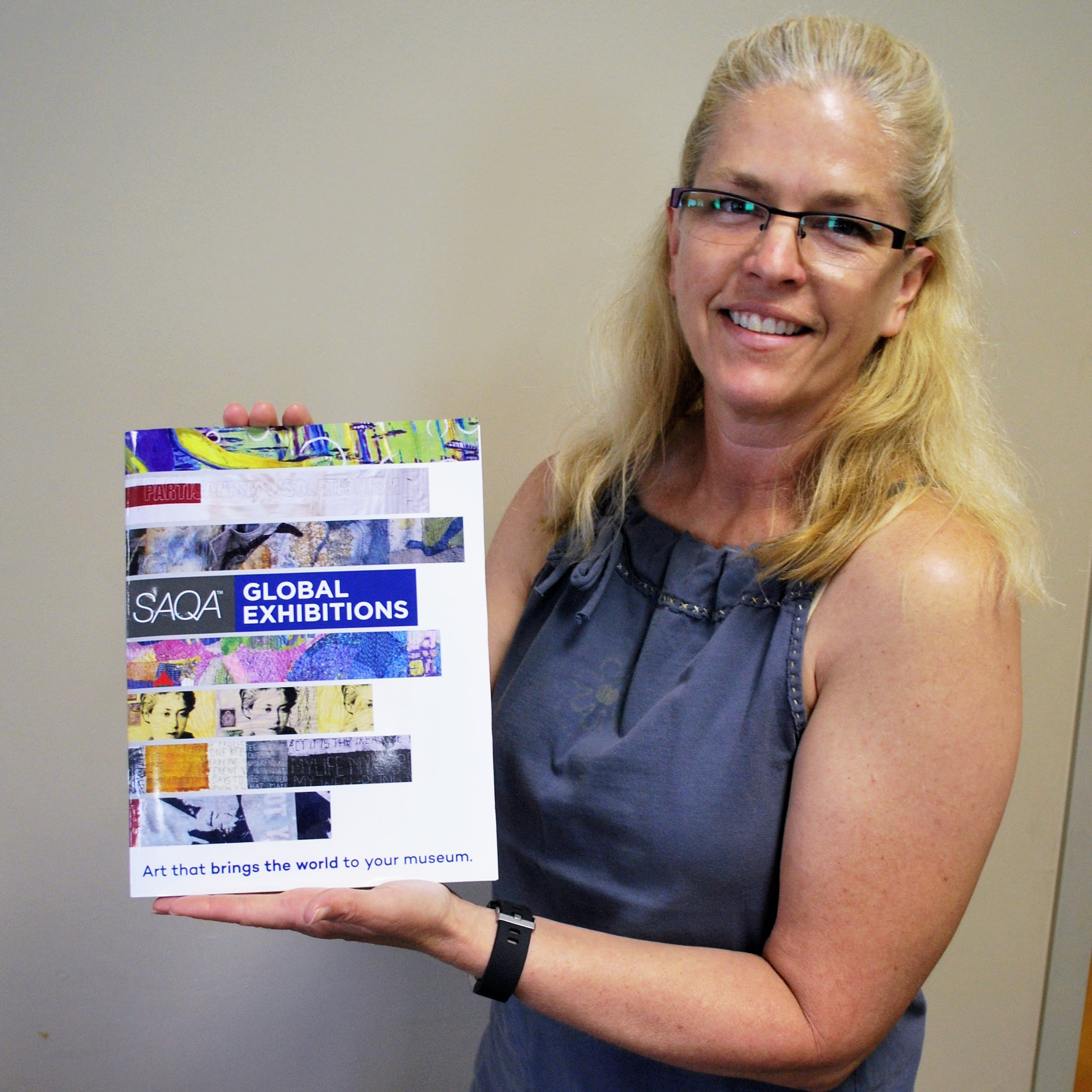 Sara Bradshaw has a quilt featured in a SAQA catalog!