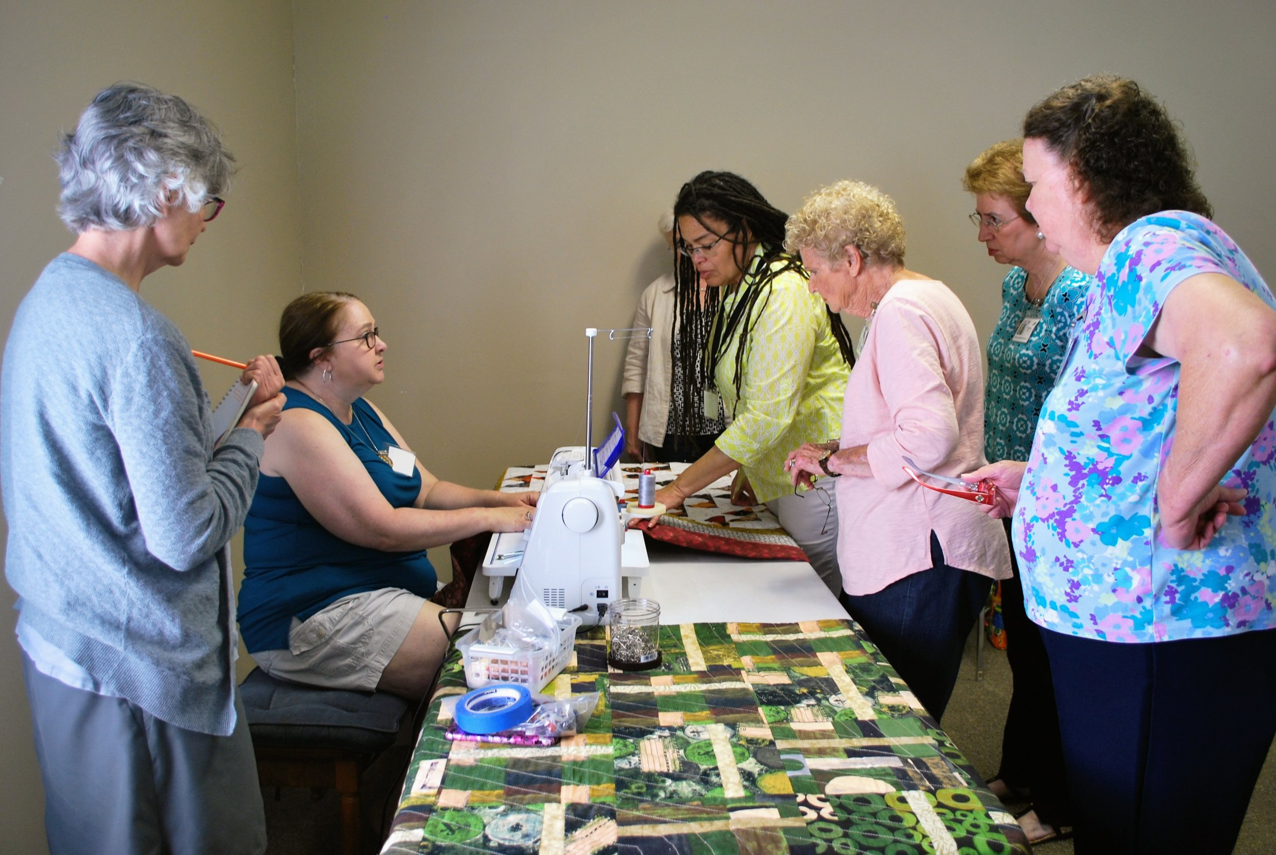 Ava Moore shows ChattMQG members how to use a sewing machine to mimic the look of hand quilting.