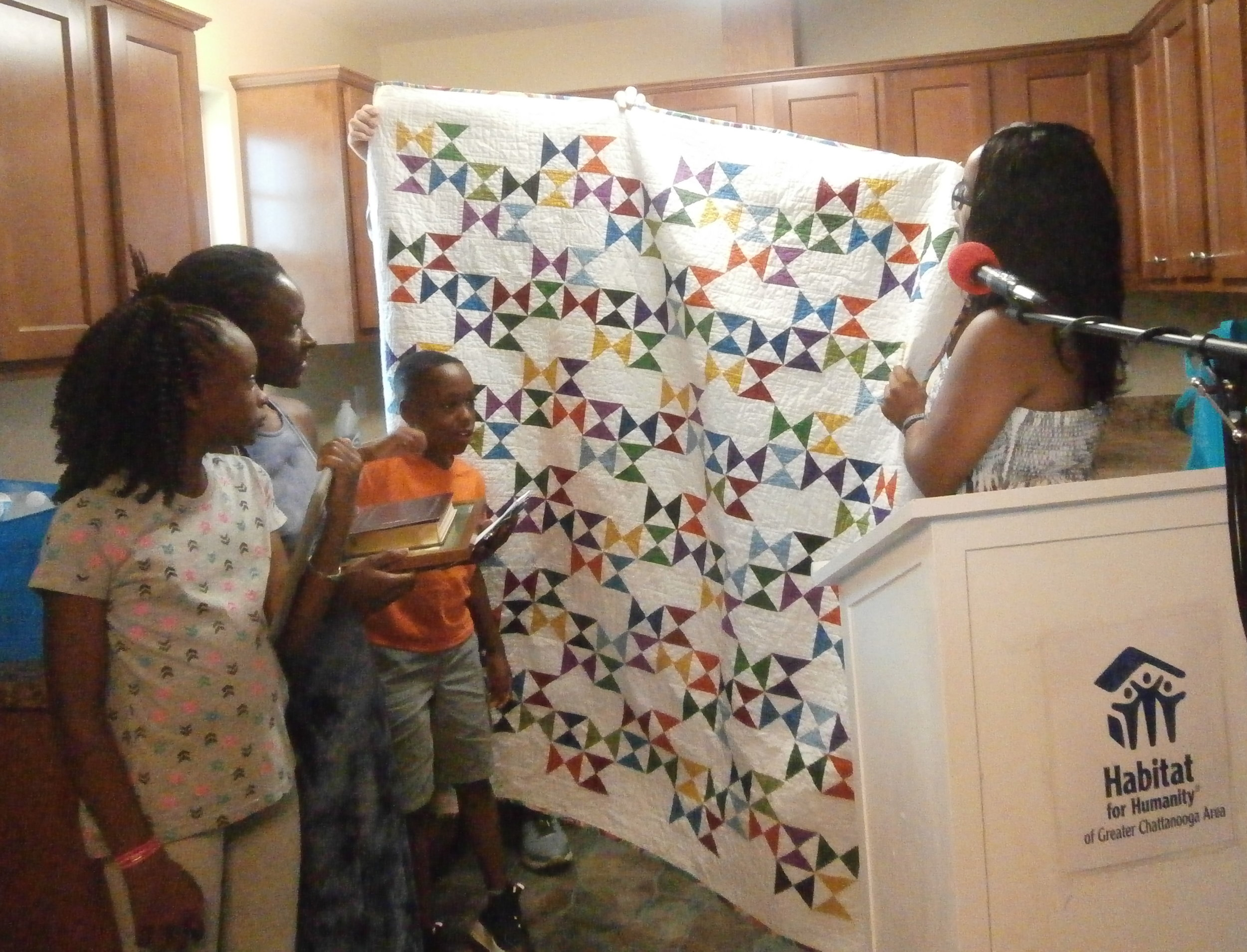 Poinita Norwood's family admires their new quilt