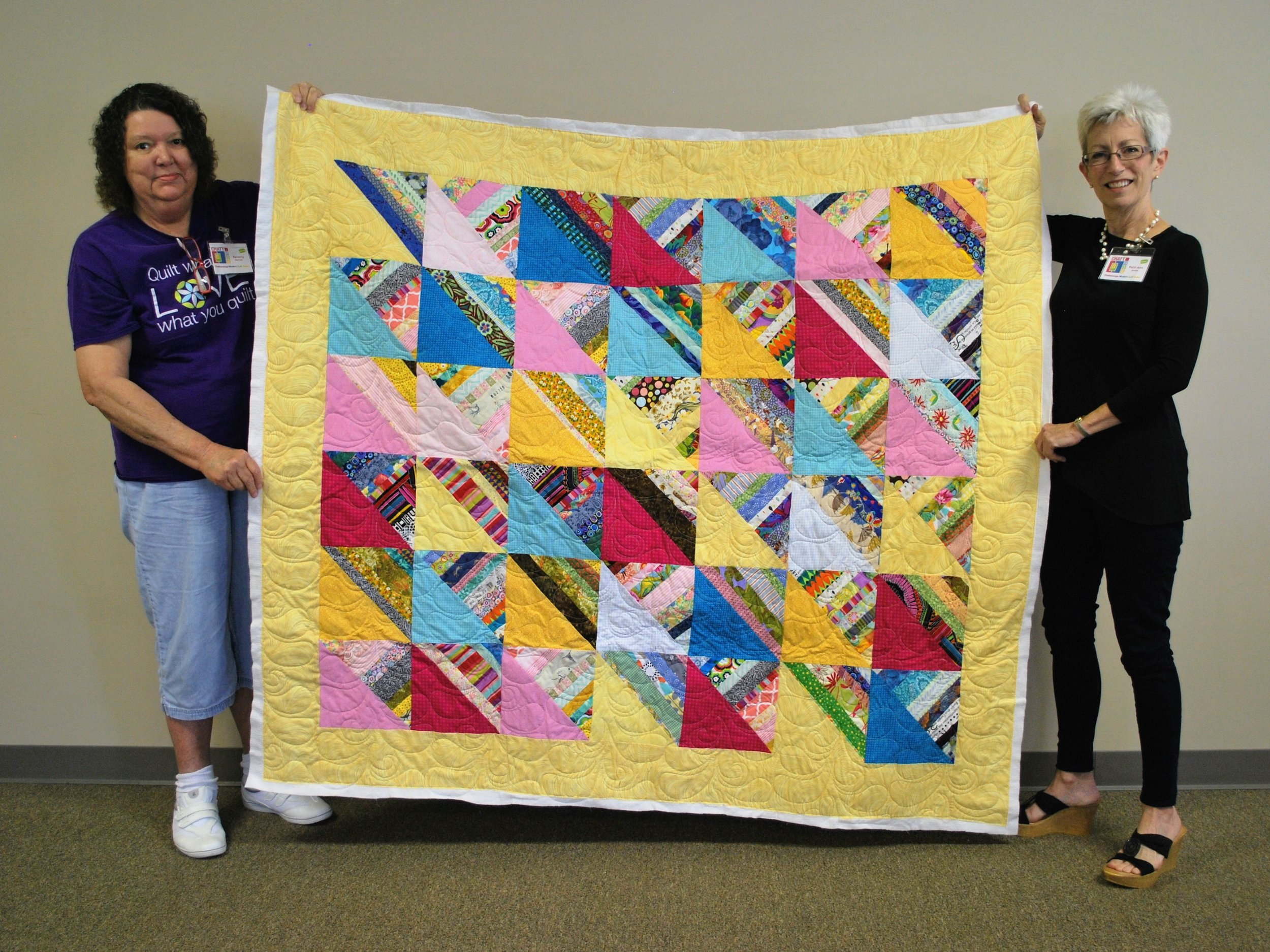 Beverly Herron (left) quilted this top pieced by Patti Ann Smith (right)