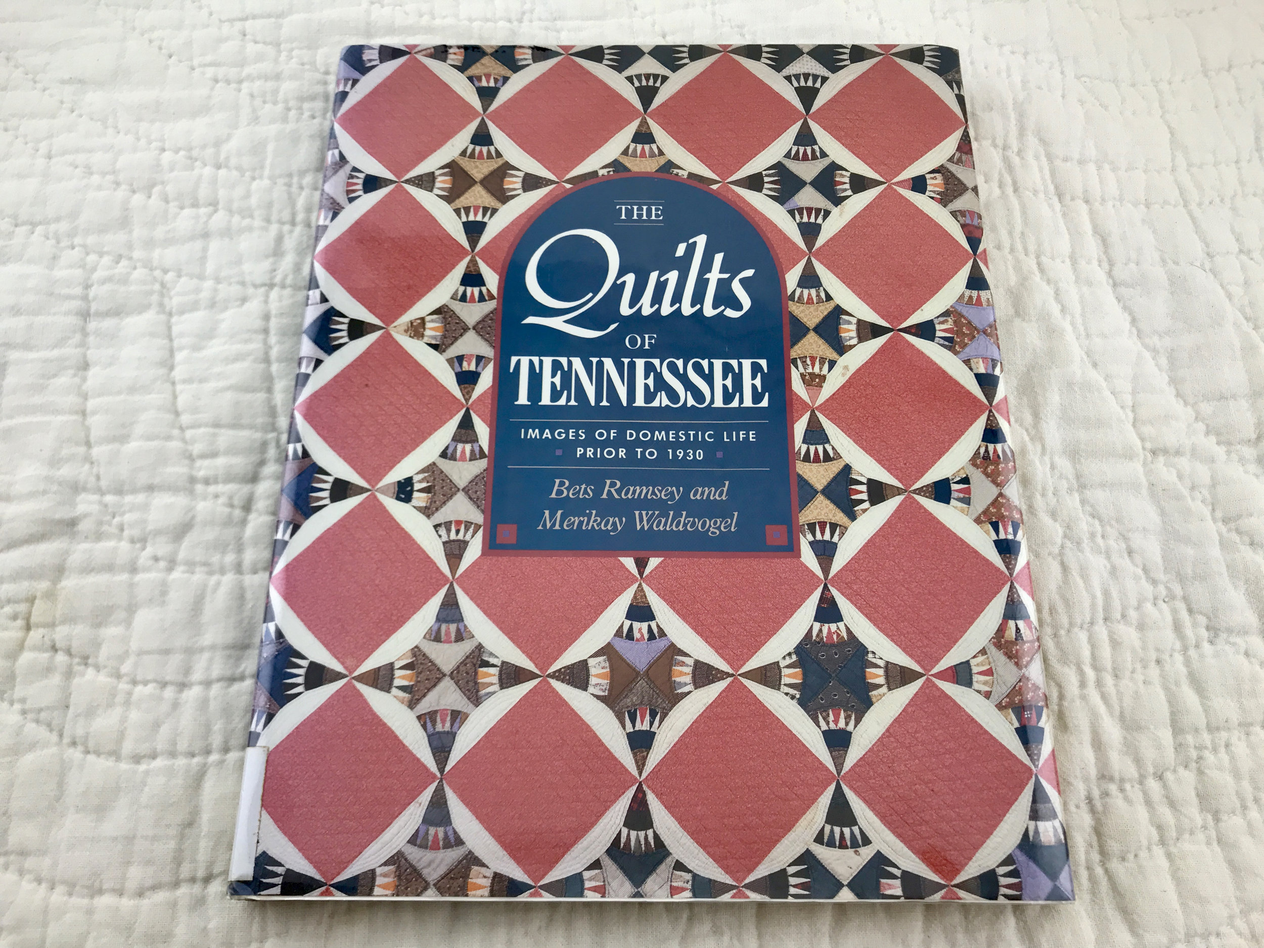 Our 2019 QuiltCon Charity Quilt Challenge entry will be inspired by an antique quilt in this book