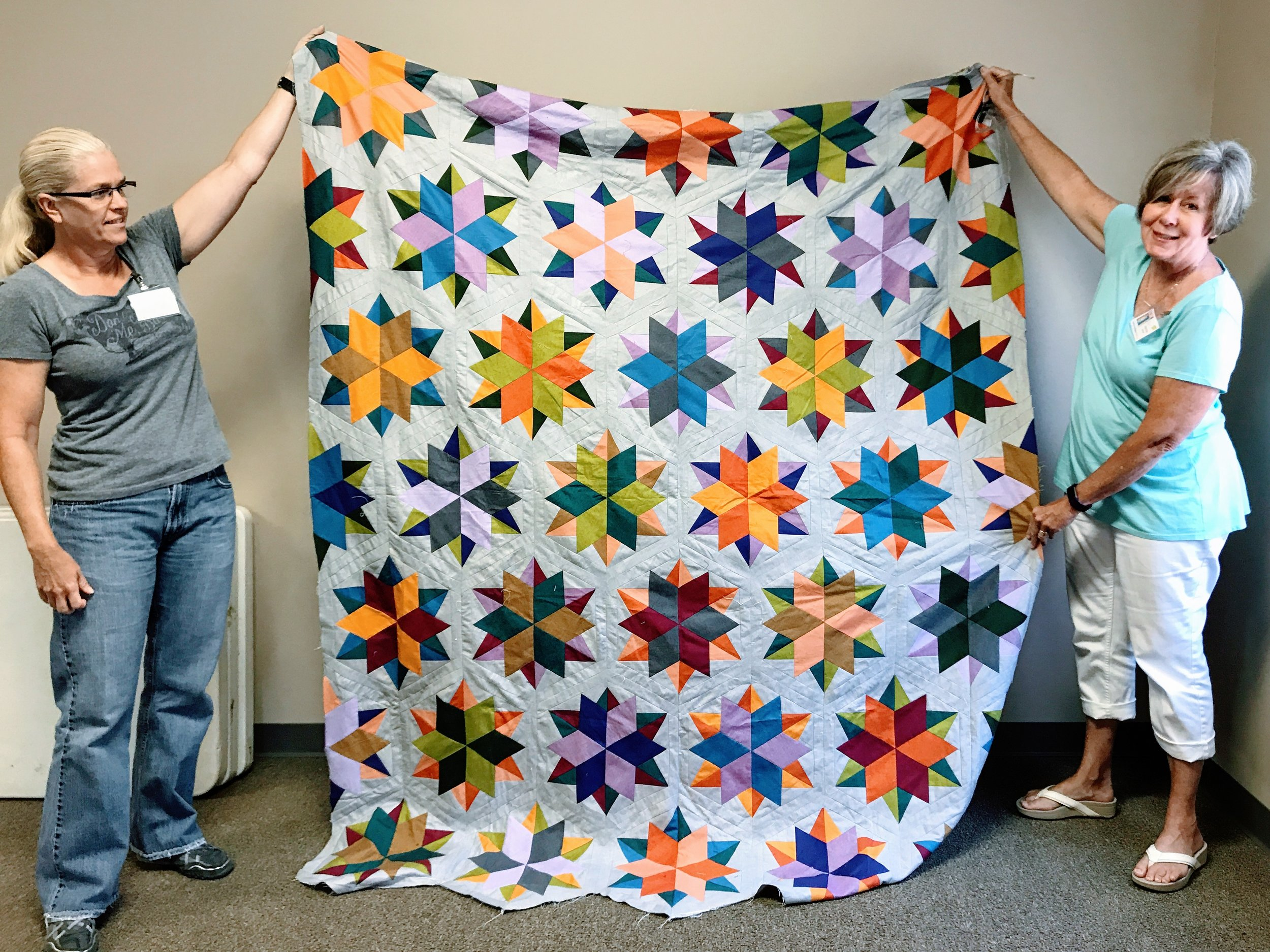 Quilt top by Pat Barber (right)