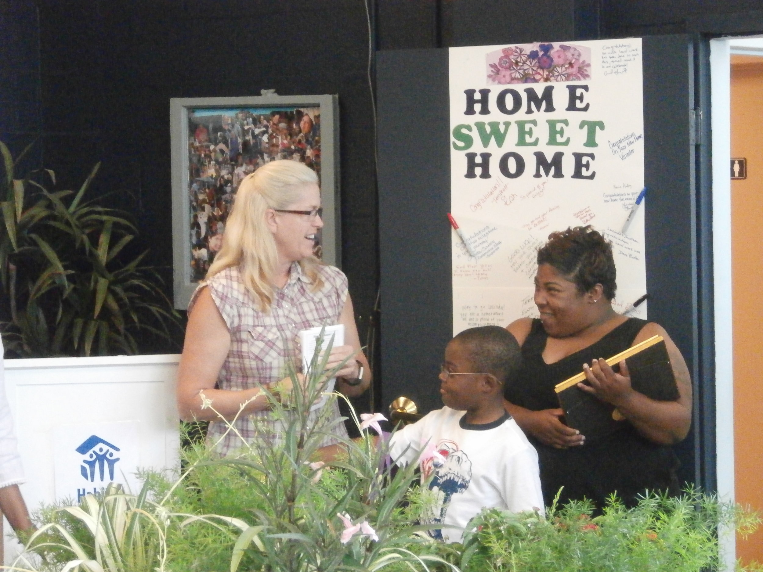 Sara congratulates homeowner Lucinda Watkins and her son on their new home
