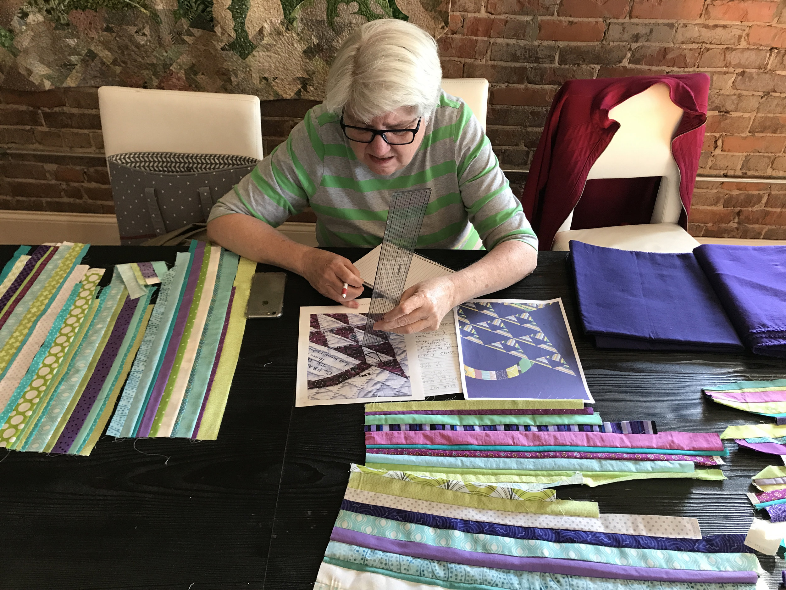 Jean works out the math and engineering required to construct the quilt top.