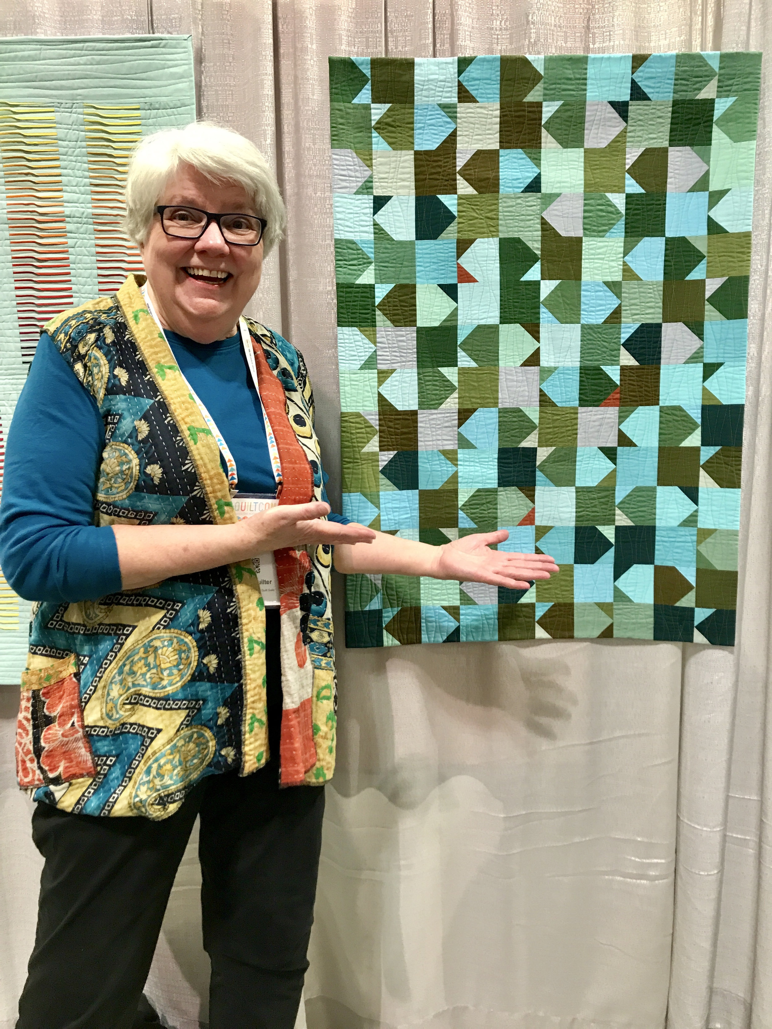 "Jean Larson and her quilt ""Seaweed"""