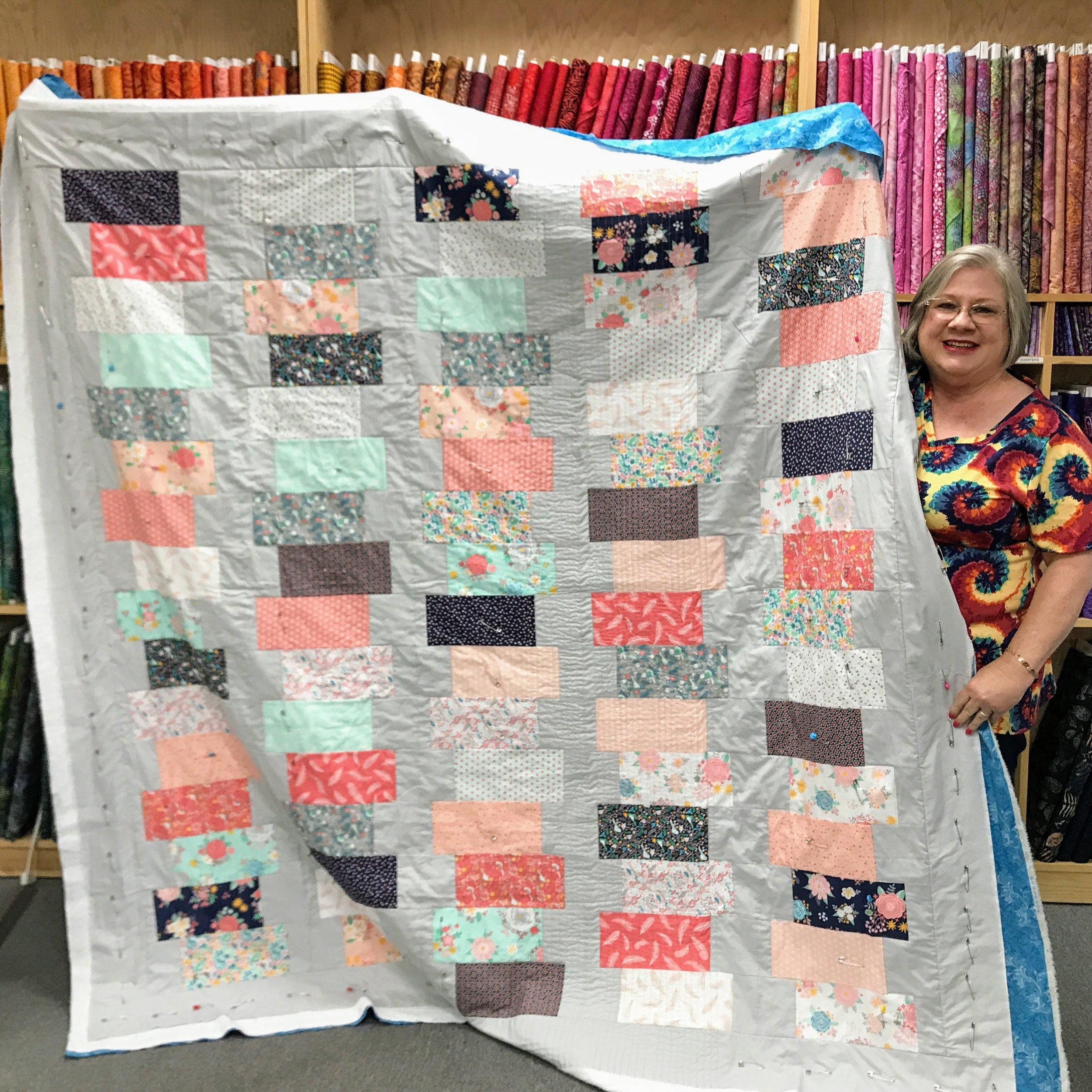 Kaye Laymance is in the midst of straight-line quilting.