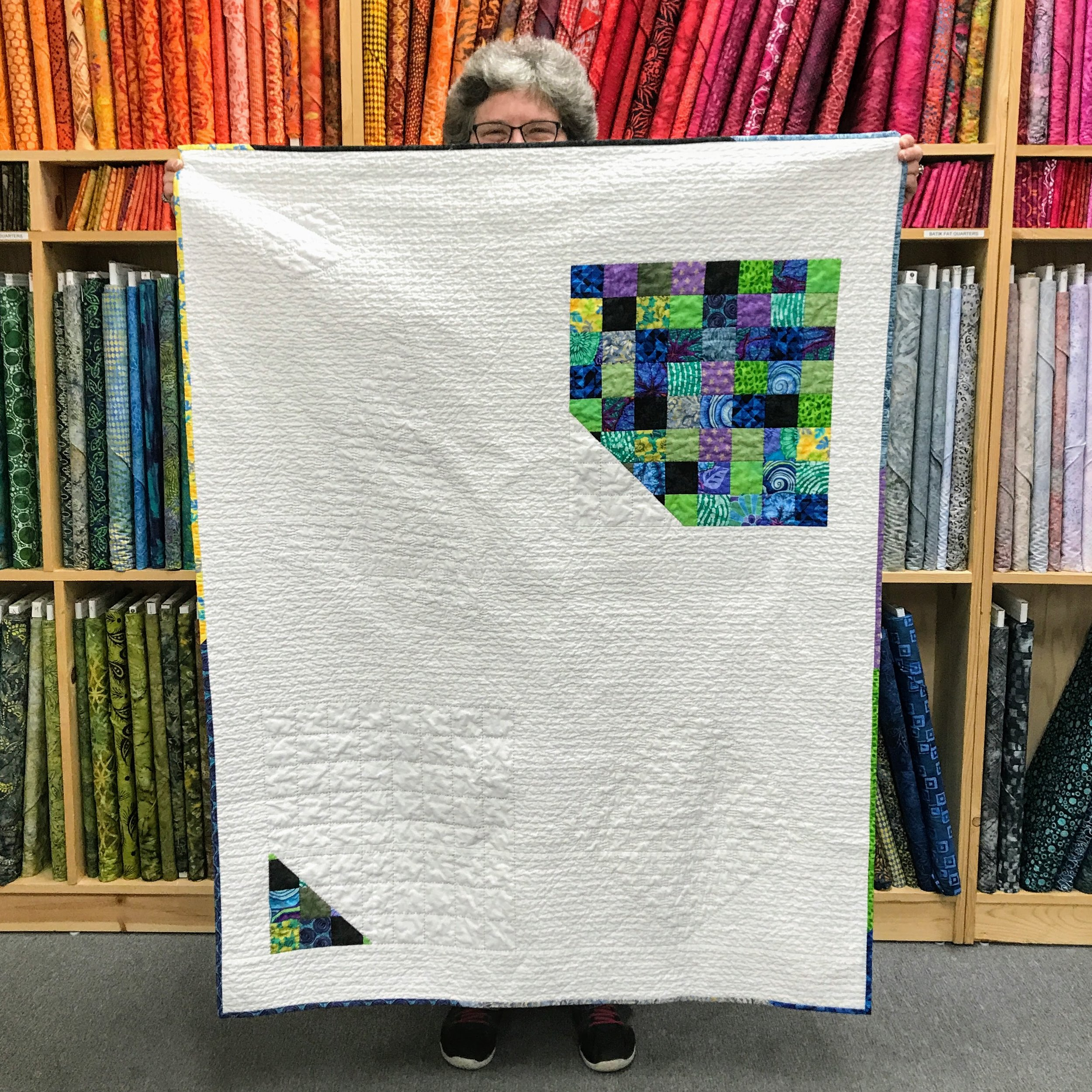 New member Johanna hand quilted this throw, giving it wonderful drape and texture.
