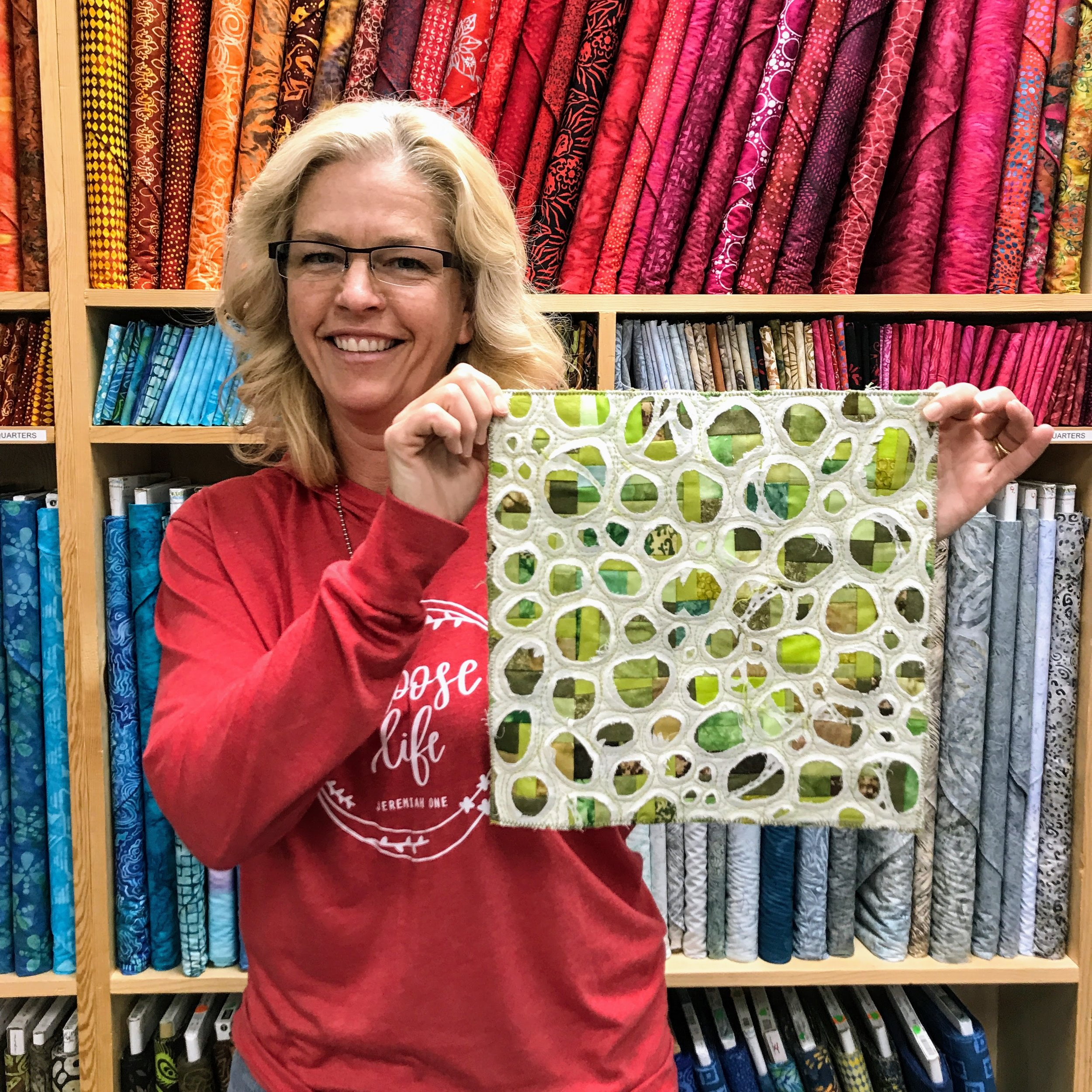 Sara Bradshaw made this mini quilt for SAQA's benefit auction. She was inspired by photos of amphibian eggs shared by fellow member Audrey Workman.