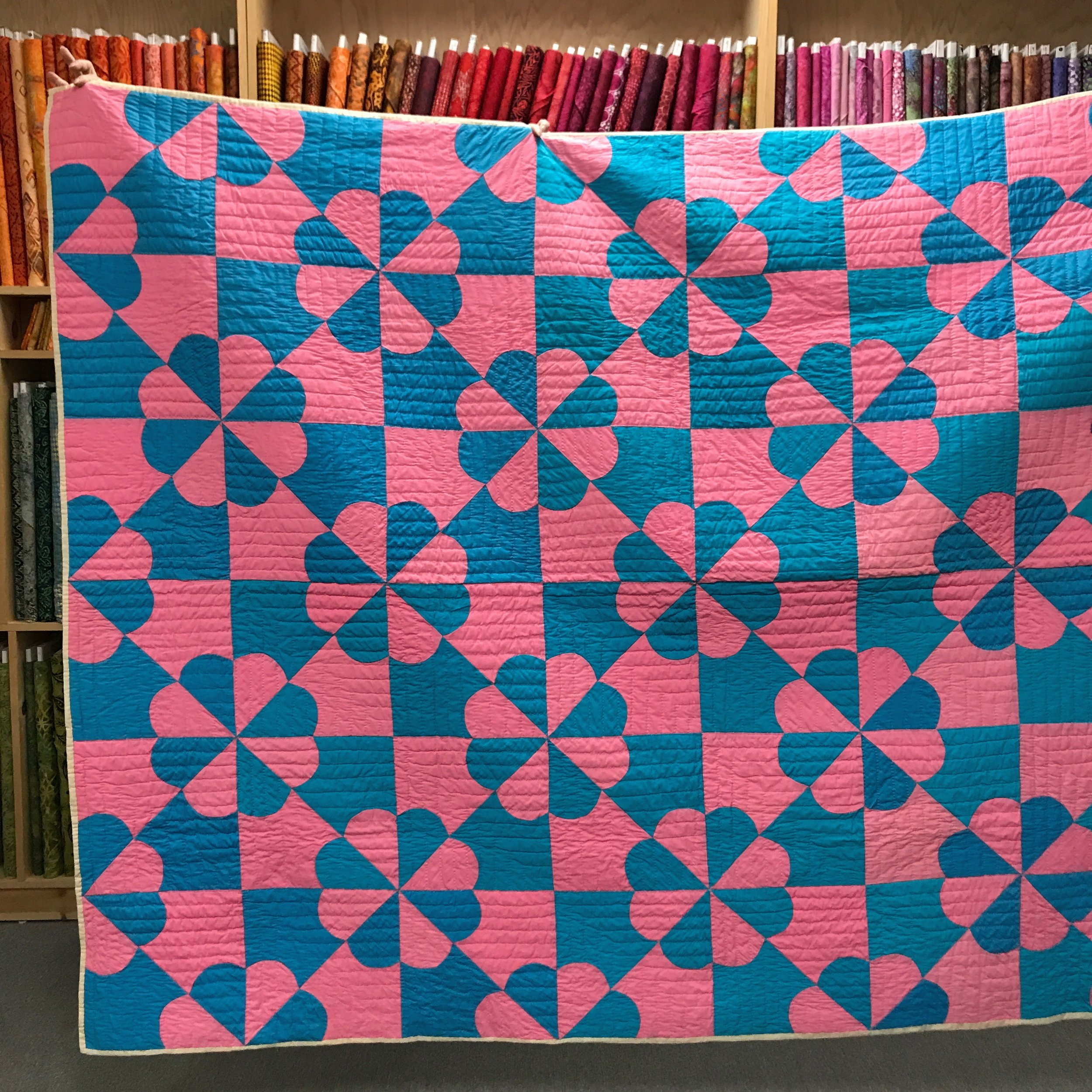 "Kelly bought this vintage quilt at an estate sale. The block is called ""hearts and gizzards""."