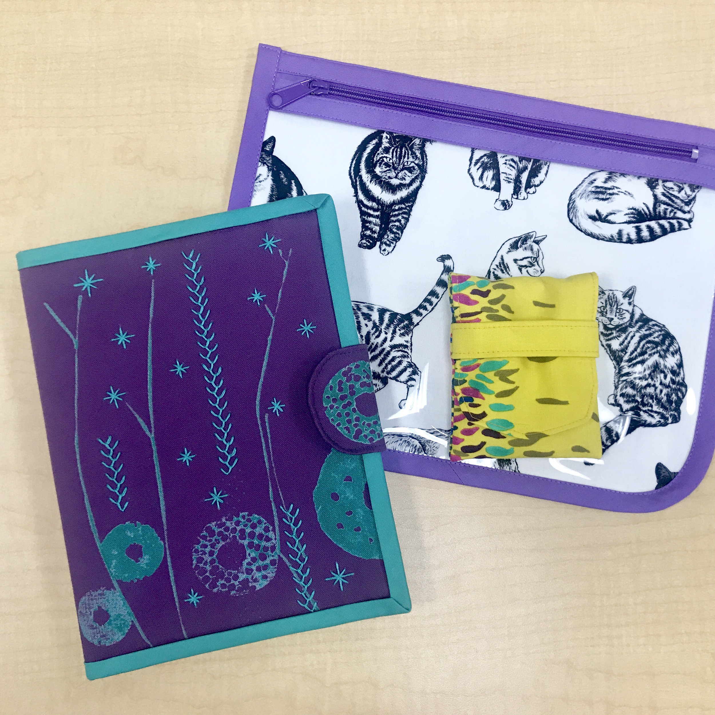 "Kelly Spell made all of these pouches from Aneela Hoey's book ""Stitched Sewing Organizers""."