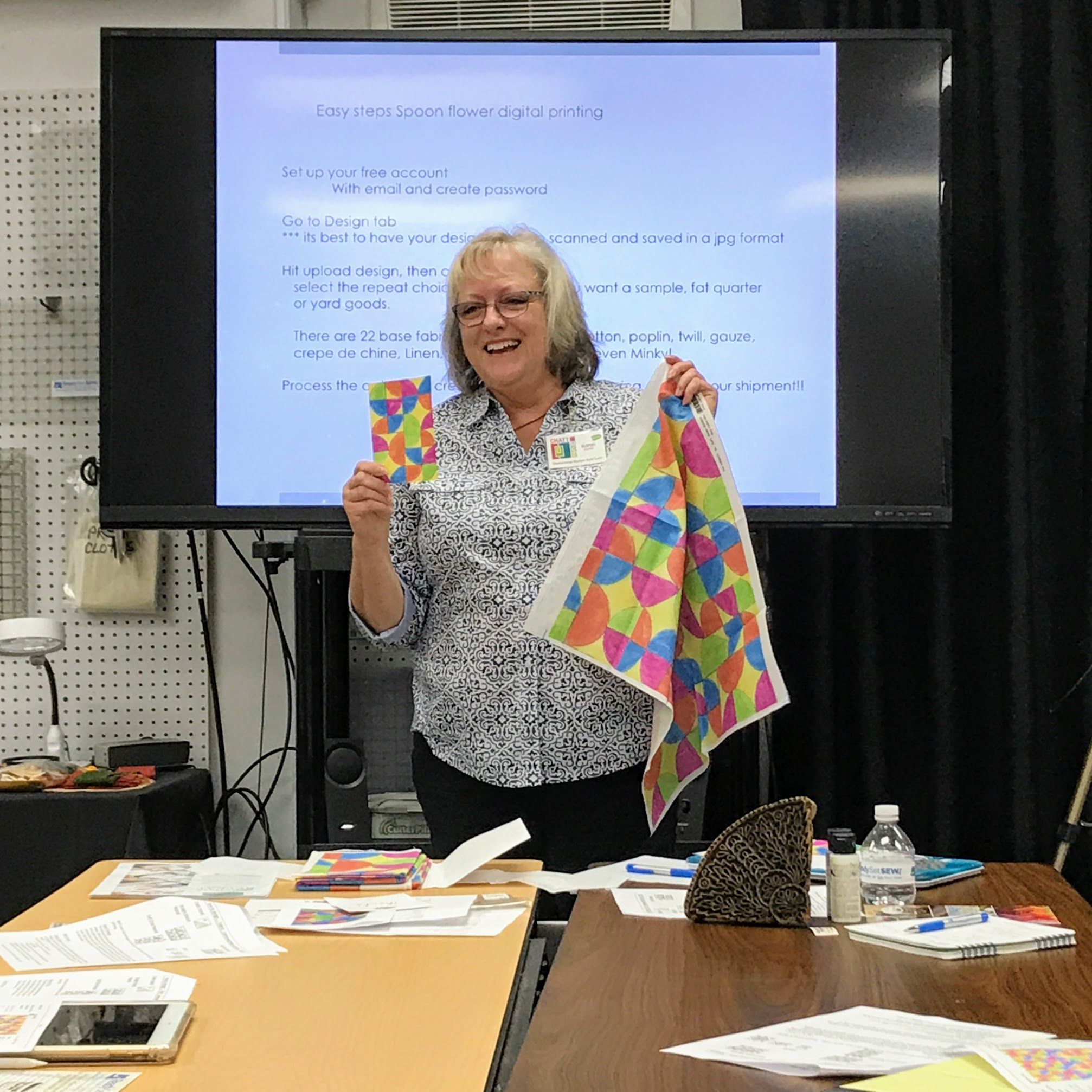 Karen Downer painted her design by hand on graph paper (left) before she converted it to a digital file to print on fabric via Spoonflower (right).