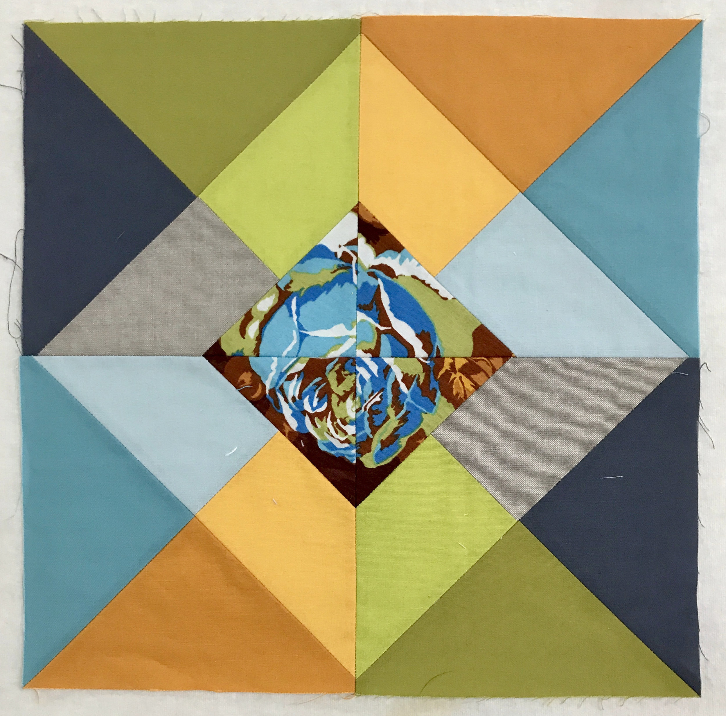 "Audrey Workman combined solid fabrics to create a transparent effect in this quilt block. The block is called ""Hourglass at Sunset"" by Kim Soper of Leland Ave Studios."