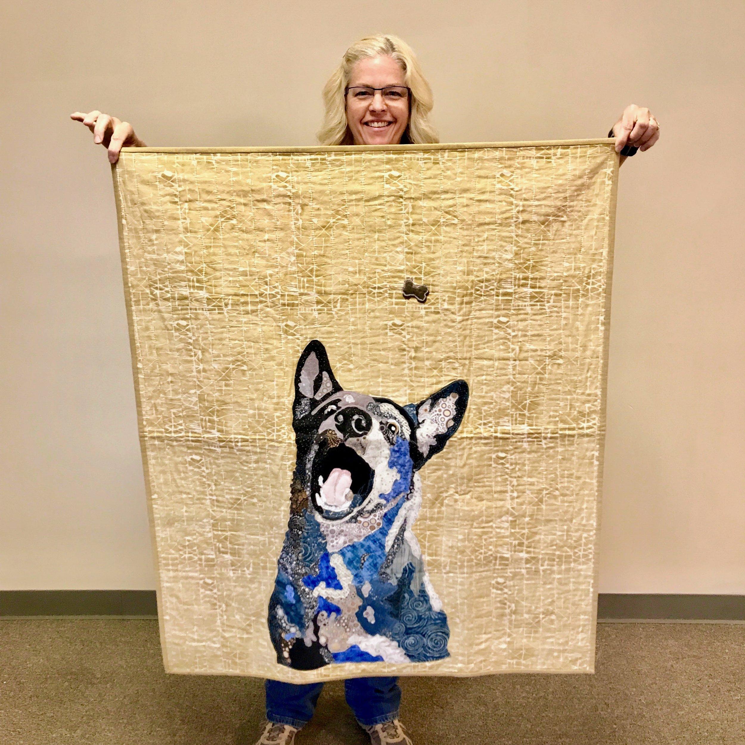 Fabric collage quilt by Sara Bradshaw