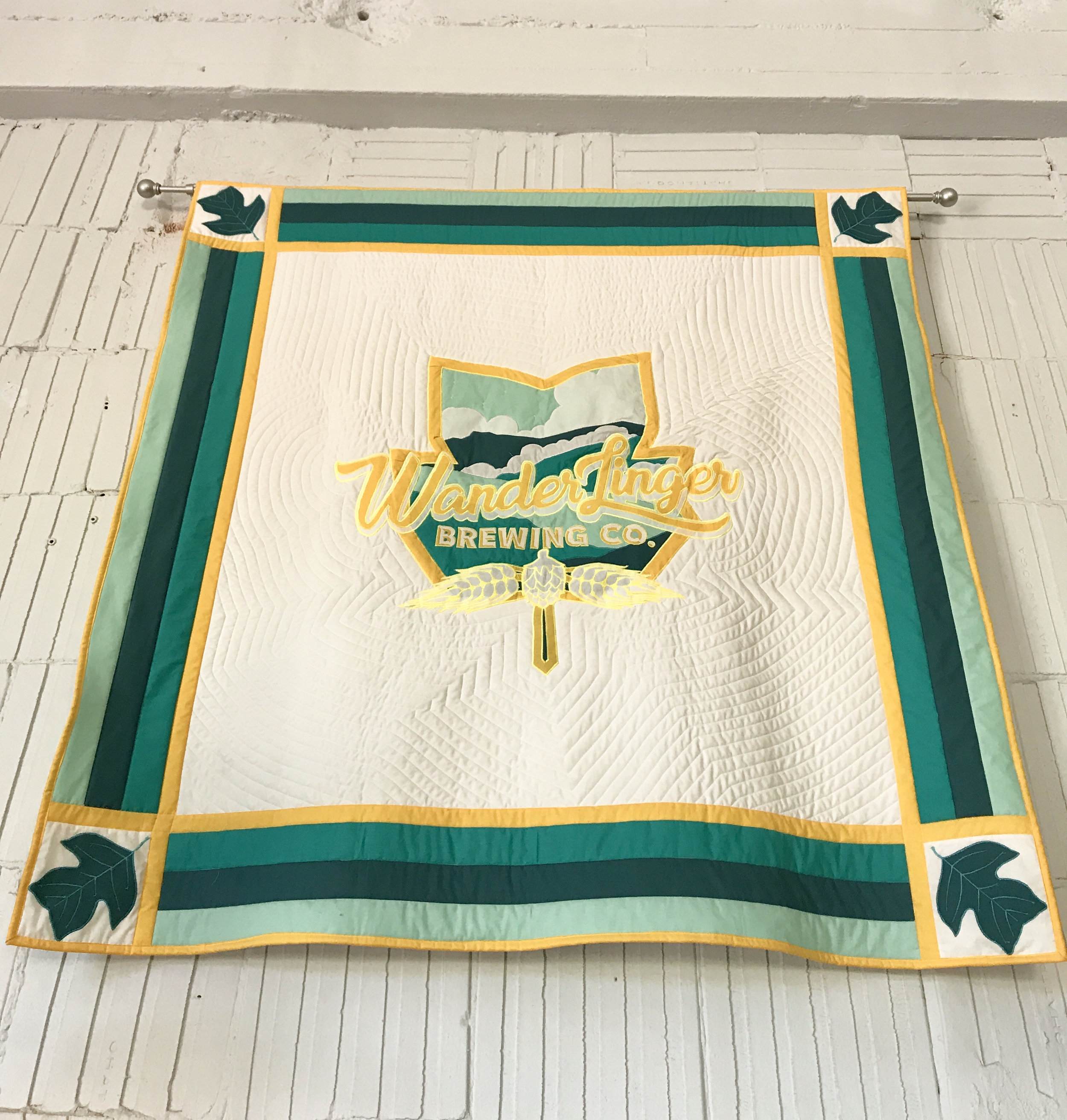 The owner's mother-in-law made this quilted banner for the brewery.
