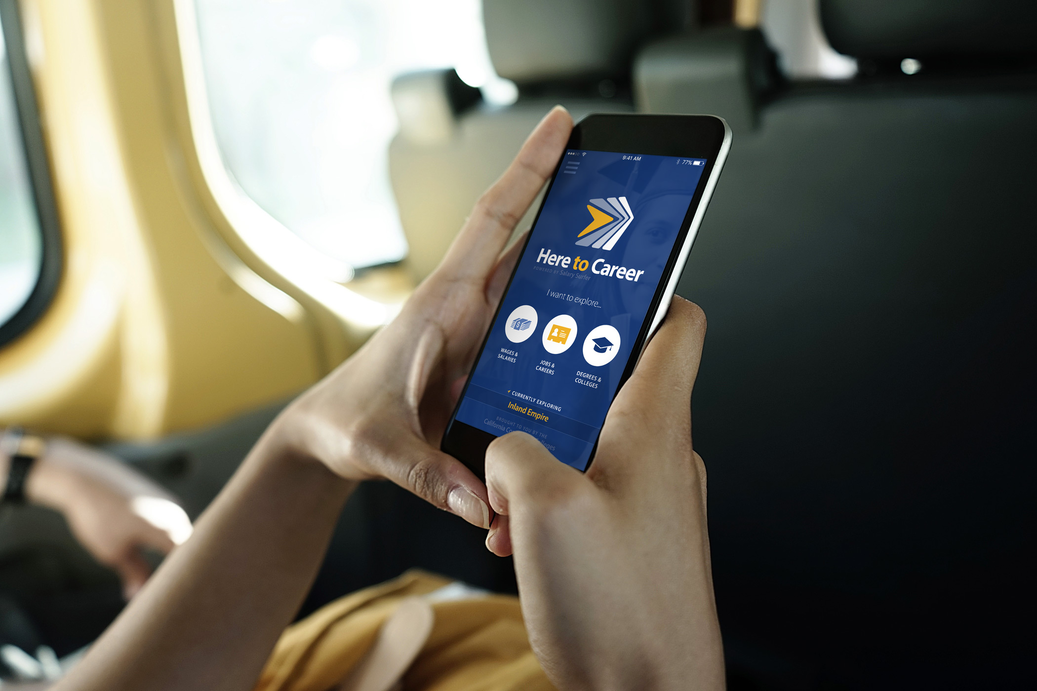 A person holding a smartphone with the Here to Career app on screen.