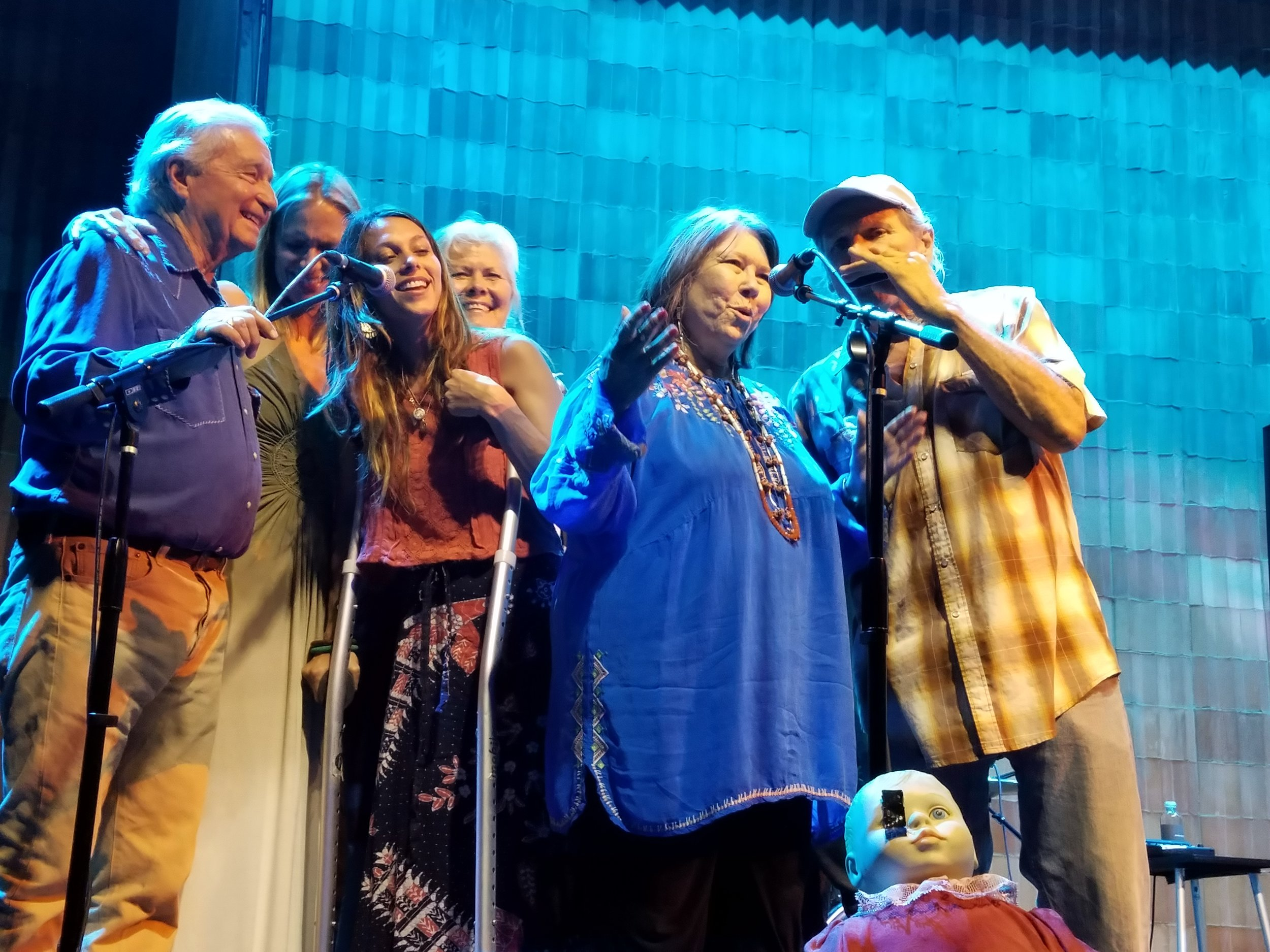 Jo Harvey Allen, center in blue smock at Marfa, Texas concert celebrating her 55th anniversary. Dick DeGuerin on left.