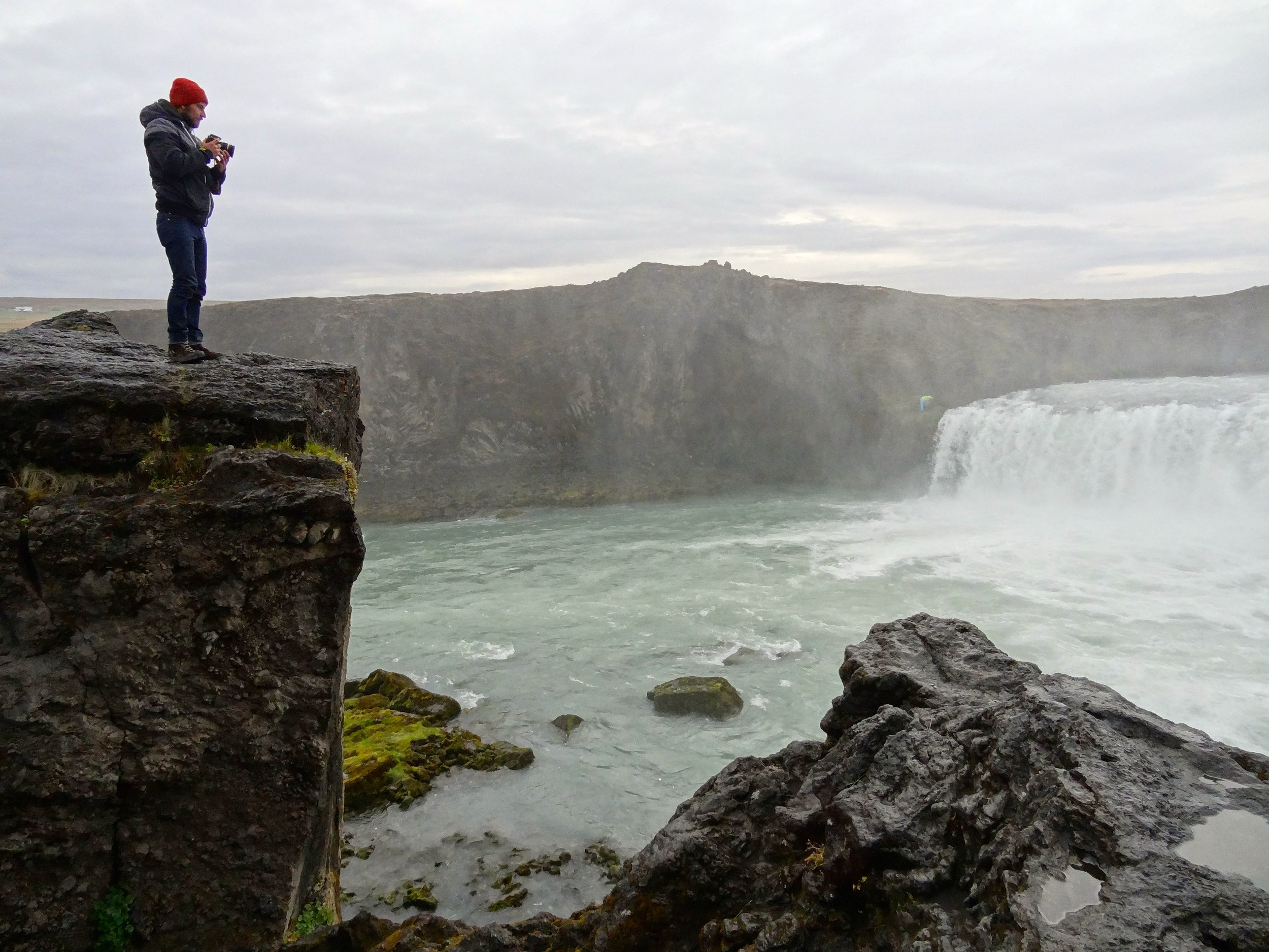 Lone photographer at Godafoss waterfall, Iceland.