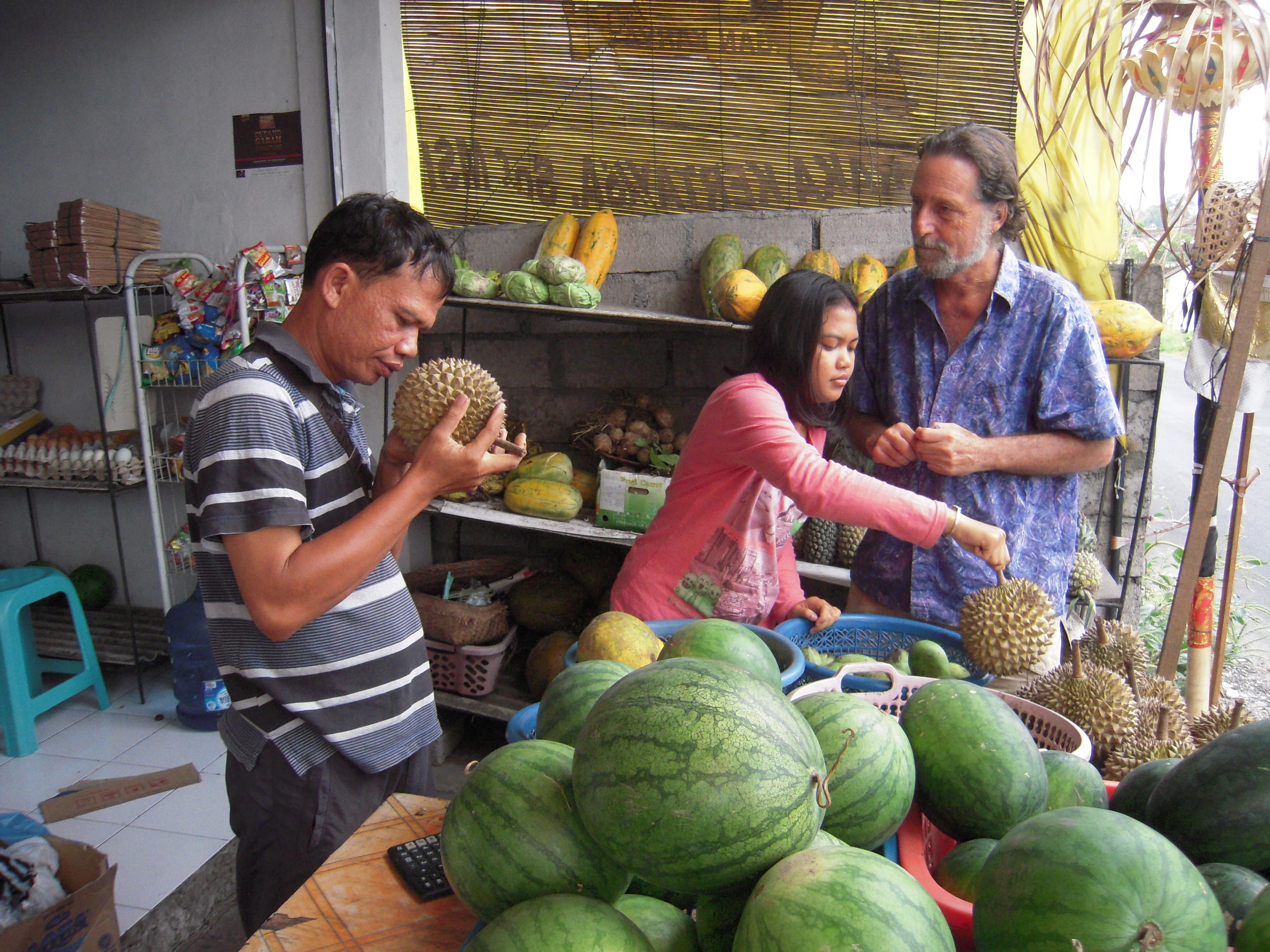 BALI 2014. Our host Joel Singer at grocery stand.JPG