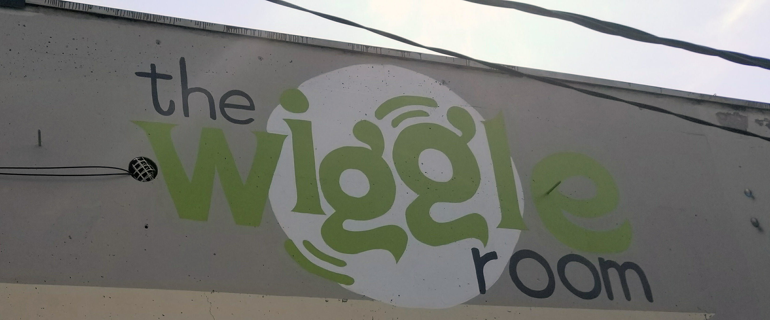 Close-up - The Wiggle Room Painted on the Building