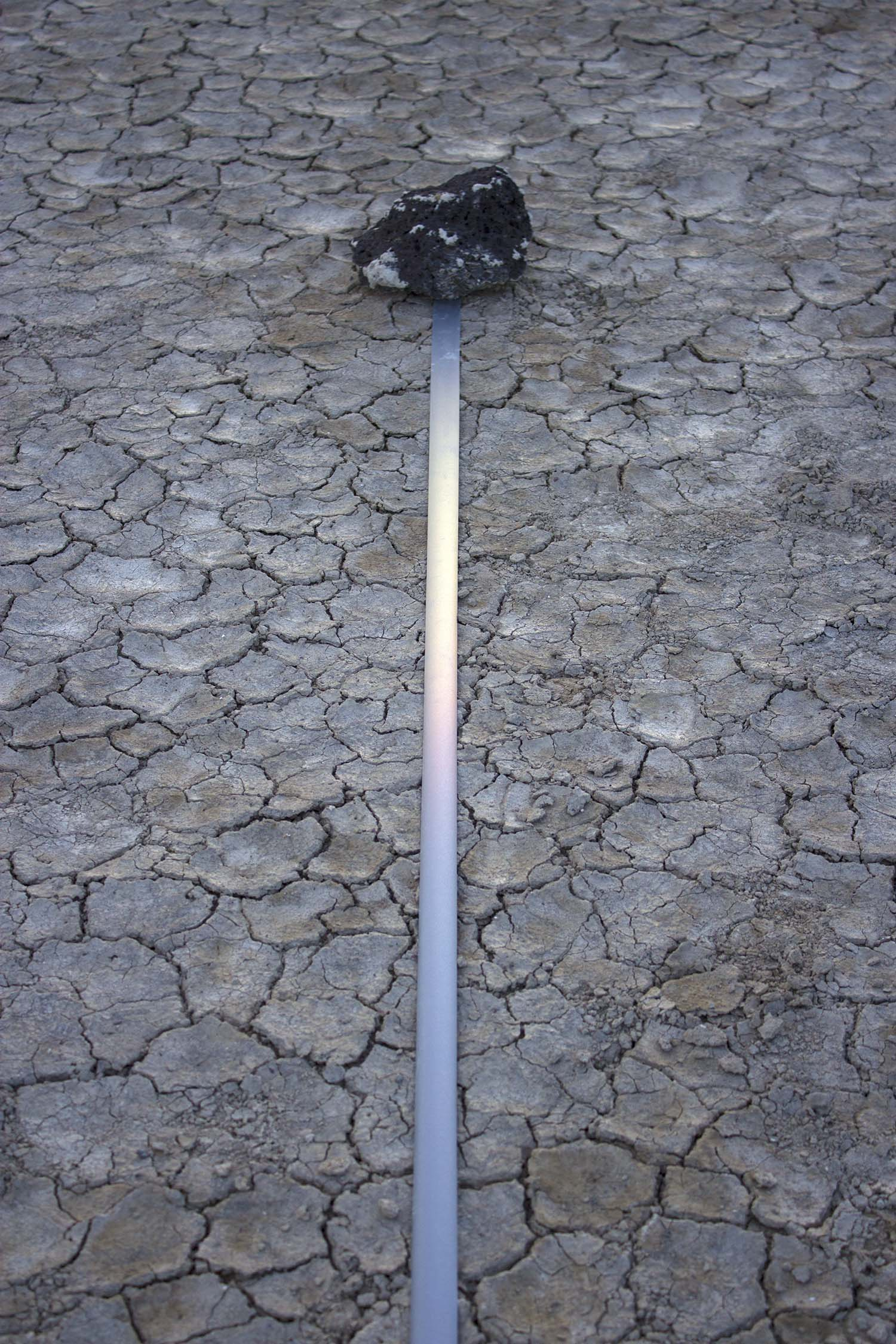 marking time in light  , 2014 (detail) reflective fabric tape, found stones, natural light 8.5 x 1.5 x 1494 in.  Alvord Desert, Eastern Oregon