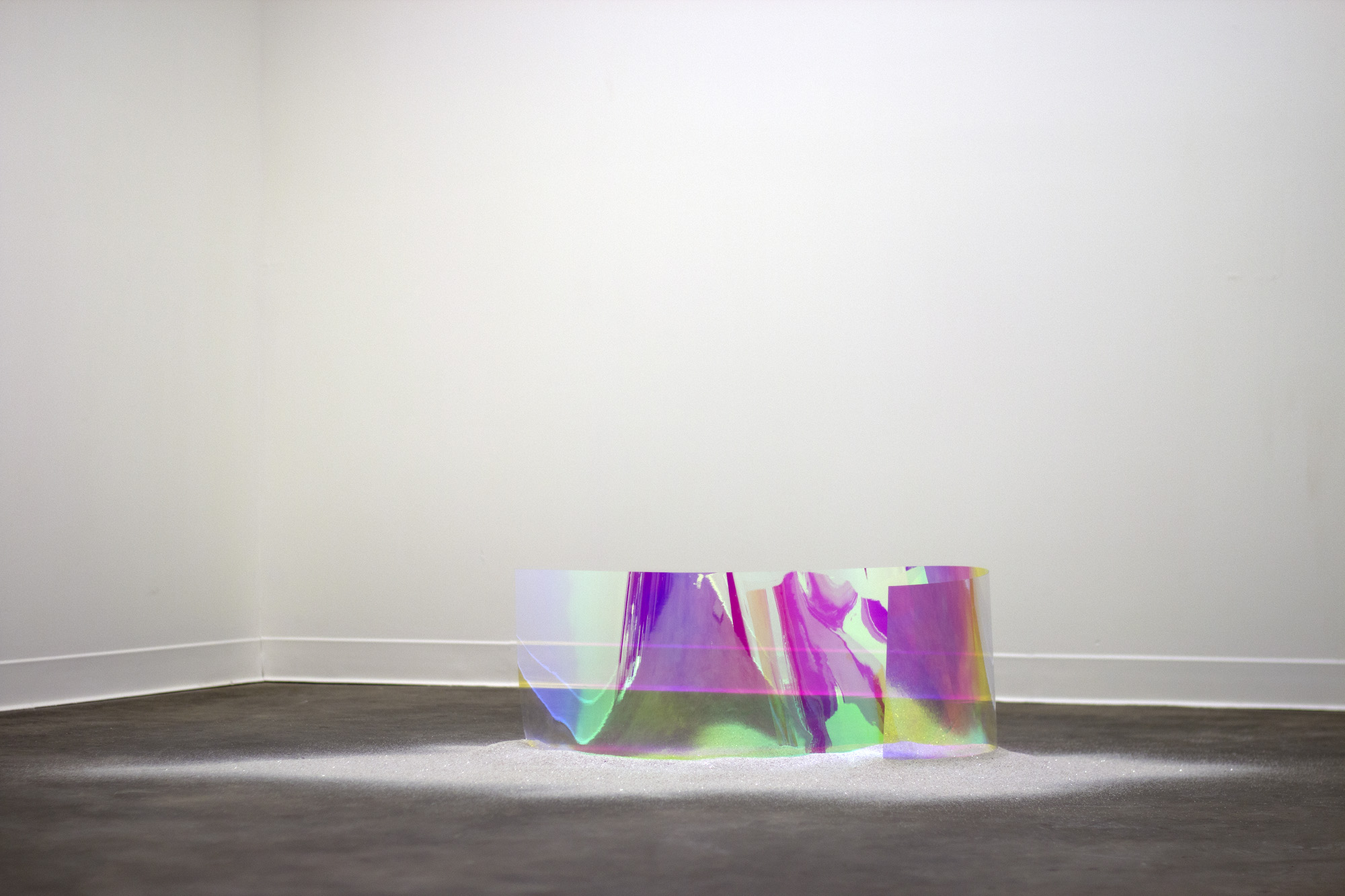fissure  , 2015 dichroic film, quartz dust 12 x 58 x 30 in. as installed