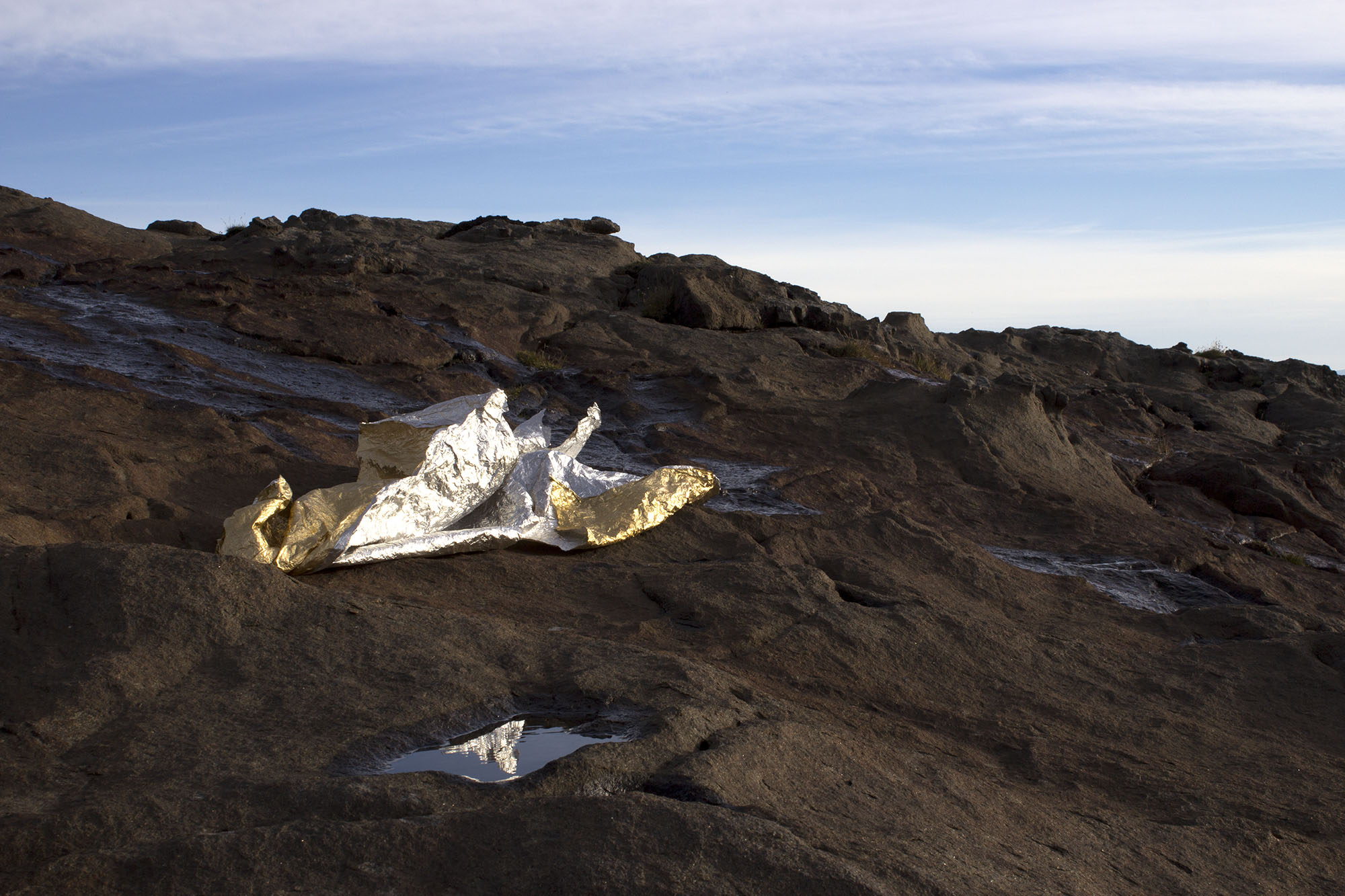 lifting, settling of a mountain  , 2013 foil sheet, natural light, water, wind dimensions variable  Spákonufellshöfði, Skagaströnd, Iceland