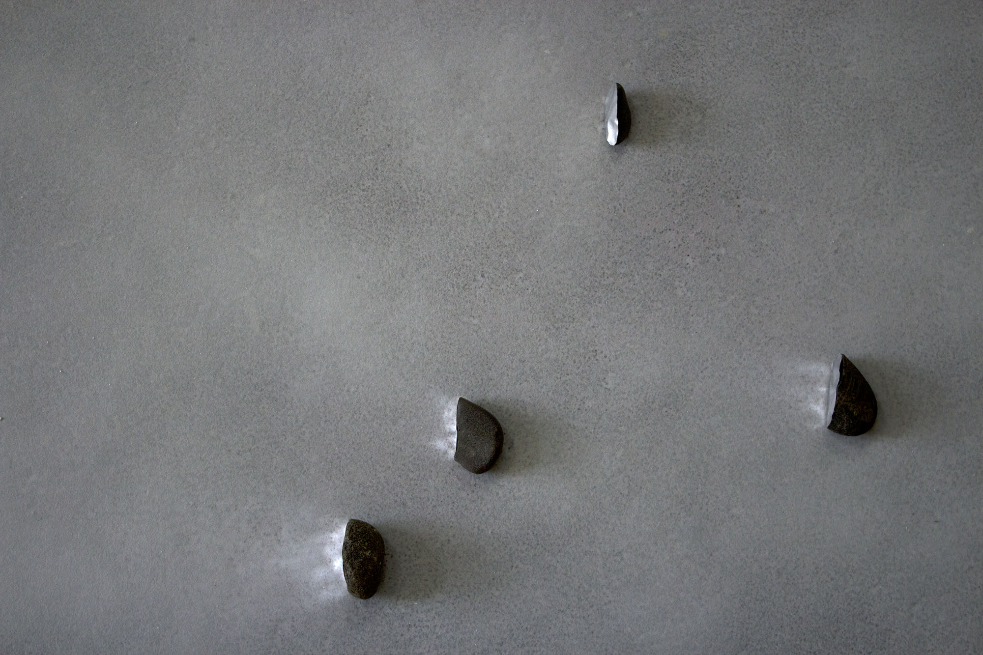 faced  , 2013 (detail) recovered stones, foil tape, glass microspheres, natural light dimensions variable