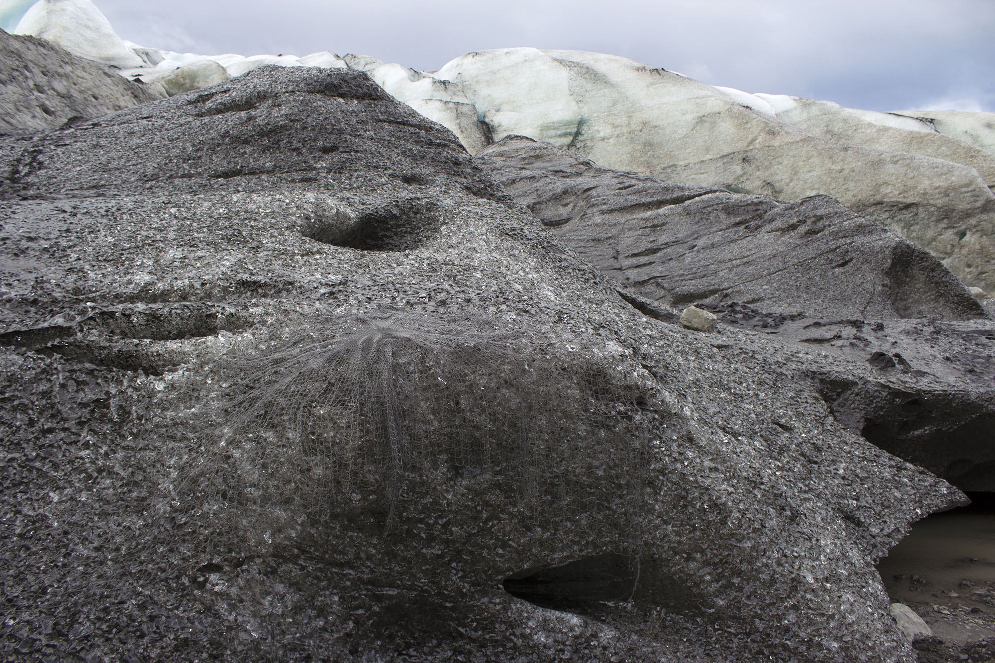 to reinforce a glacier  , 2017 hand-beaded net, glacial tongue site-responsive installation  Fláajökull, Vatnajökull, Iceland