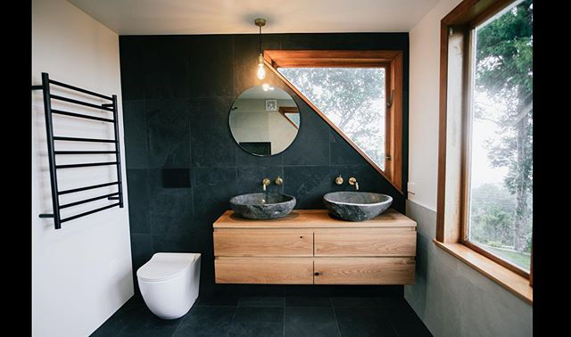 Earthy escape  A custom creation by custom bathrooms #bathroomdesign #modernbathrooms #bathroominspo #stonebowl #customvanity #bathroomrenovation #slatetiles#bathroomremodel #blackandgold #custom
