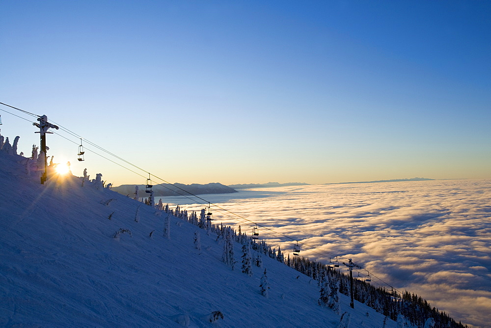 A picture taken at Big Mountain near Whitefish during the winter with clear skies above an extensive blanket of freezing fog and low clouds down below. This is common during the winter months when both upper level high pressure and surface high pressure are parked over our part of the country with clear skies in the mountains along with light winds in the valleys.
