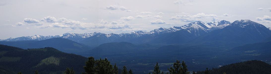An inversion free day across south Libby in Lincoln County. The absence of low clouds and haze in the lower elevations indicates ventilation or rising air also evident by the cumulus clouds. This picture was taken during the late spring when inversion conditions are less persistent and less noticeable during the daylight hours.