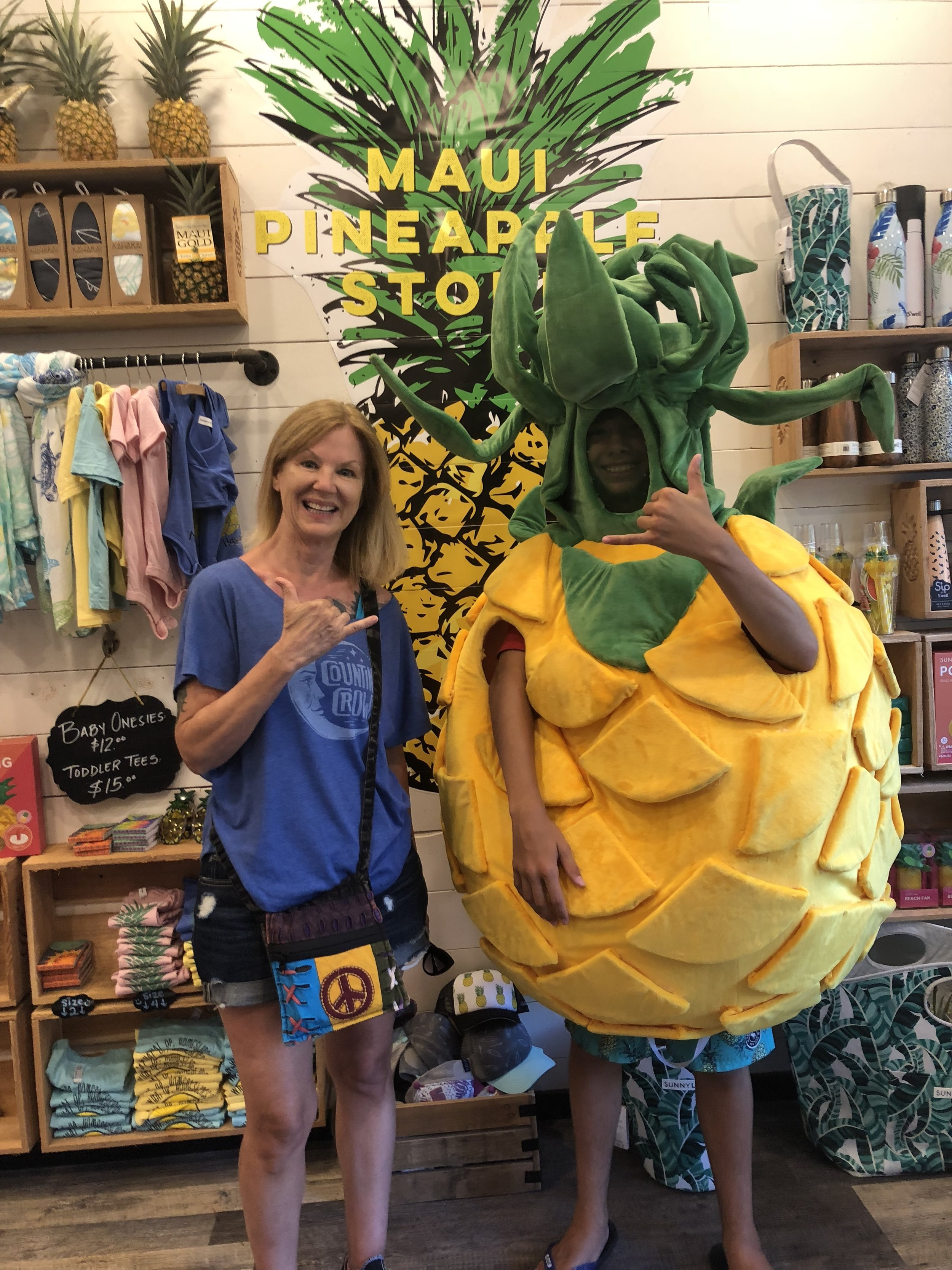 Pineapple Boy! When I had to leave my cabana, I went exploring. Just a nice kid walking by the store with his family. He saw the costume in the back of the shop and asked if he could try it on. I asked if he'd take a picture with me, and before we were done, a long line of people were waiting for pics!