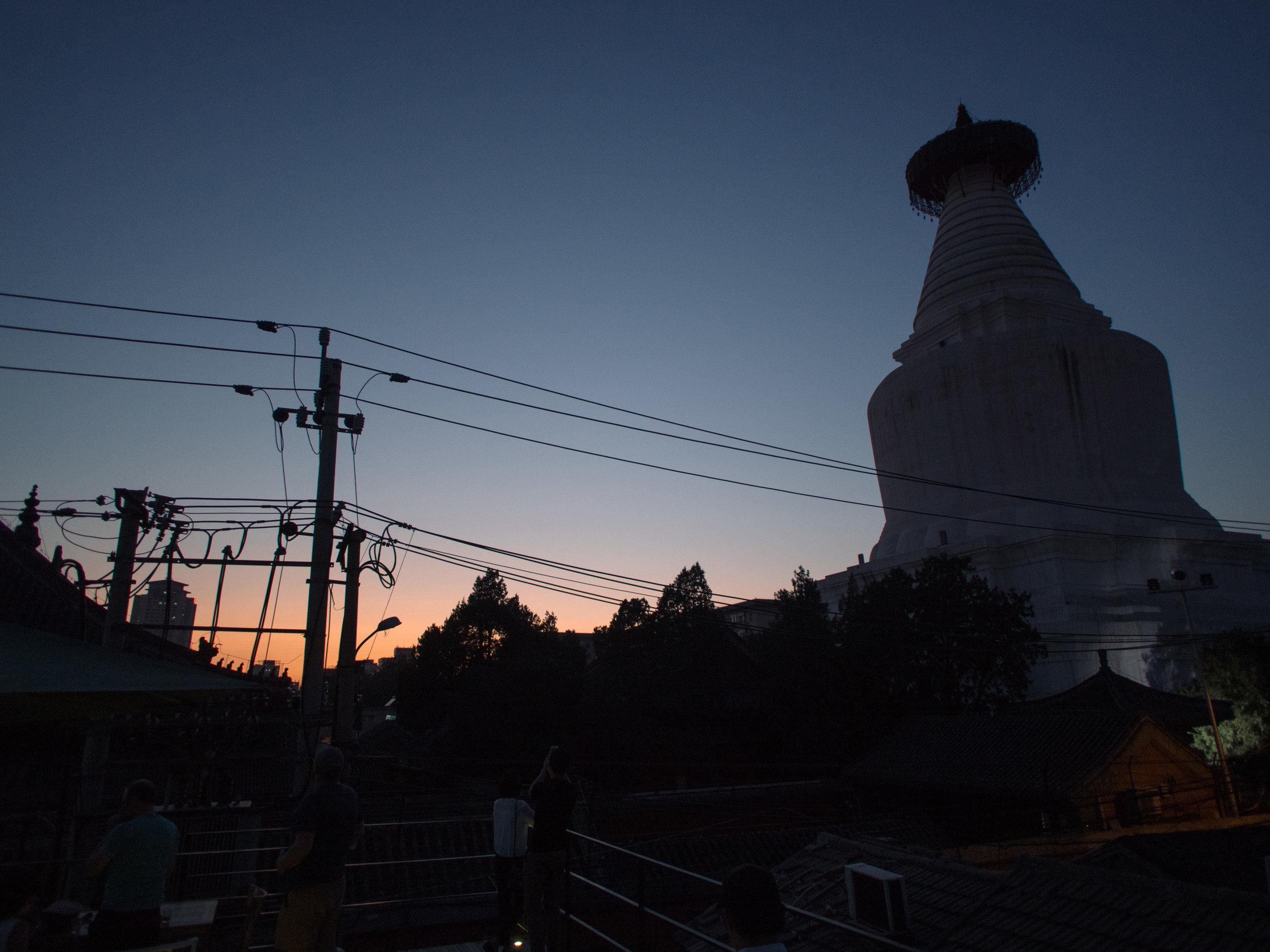 Beijing's White Cloud Pagoda (Baitasi) at dusk.