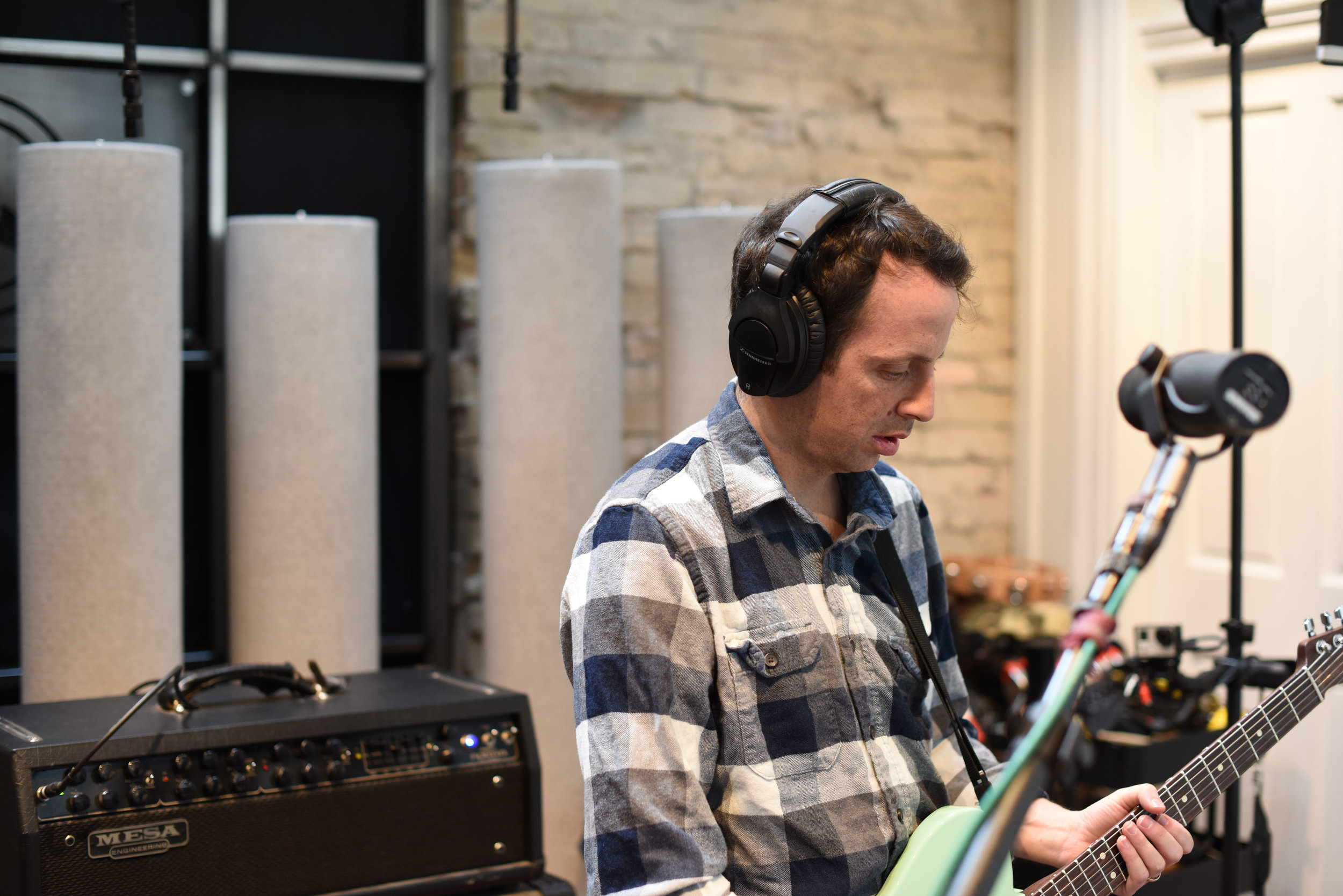 Bryce Taylor in the Studio laying down guitar tracks.