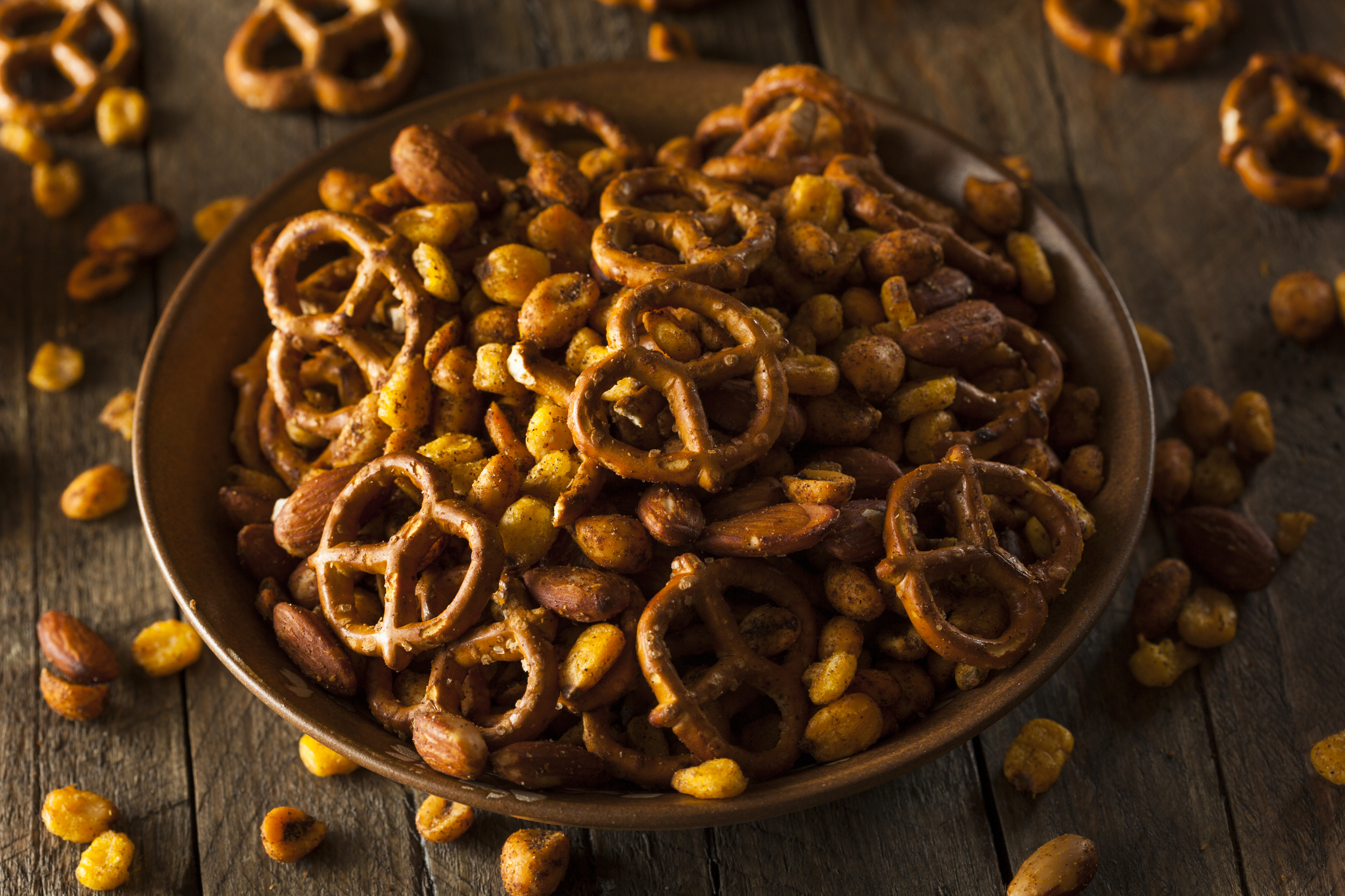 Pretzels and/or nuts are a great snack to bring along! (Image Source: iStock)