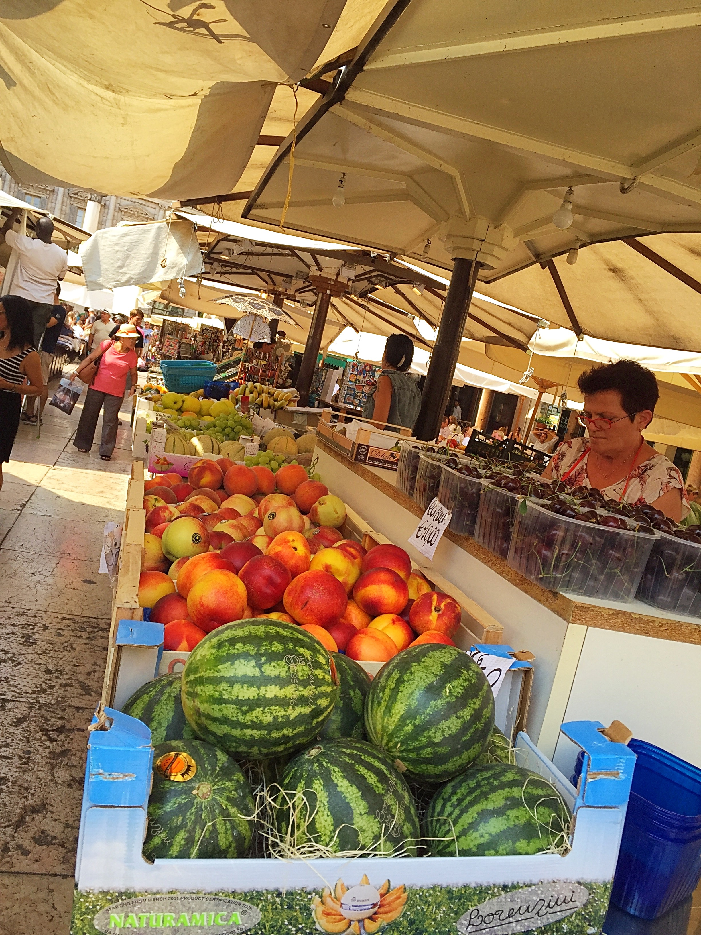 Local vendors and their kiosks selling fresh produce and souvenirs