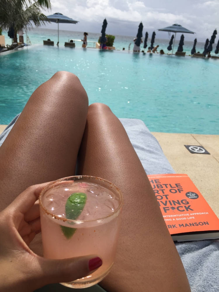 This is the life!  Pool side with a drink and a great book. Relaxation at it's best