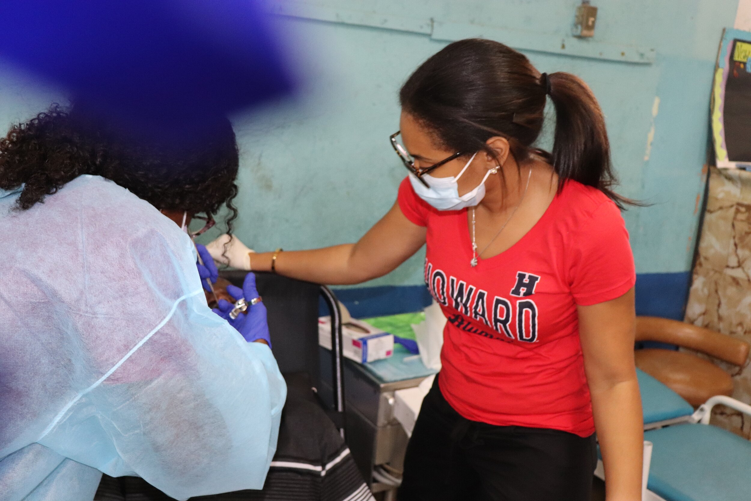 Dr. Smith with UTech dental student as anesthesia is being administered