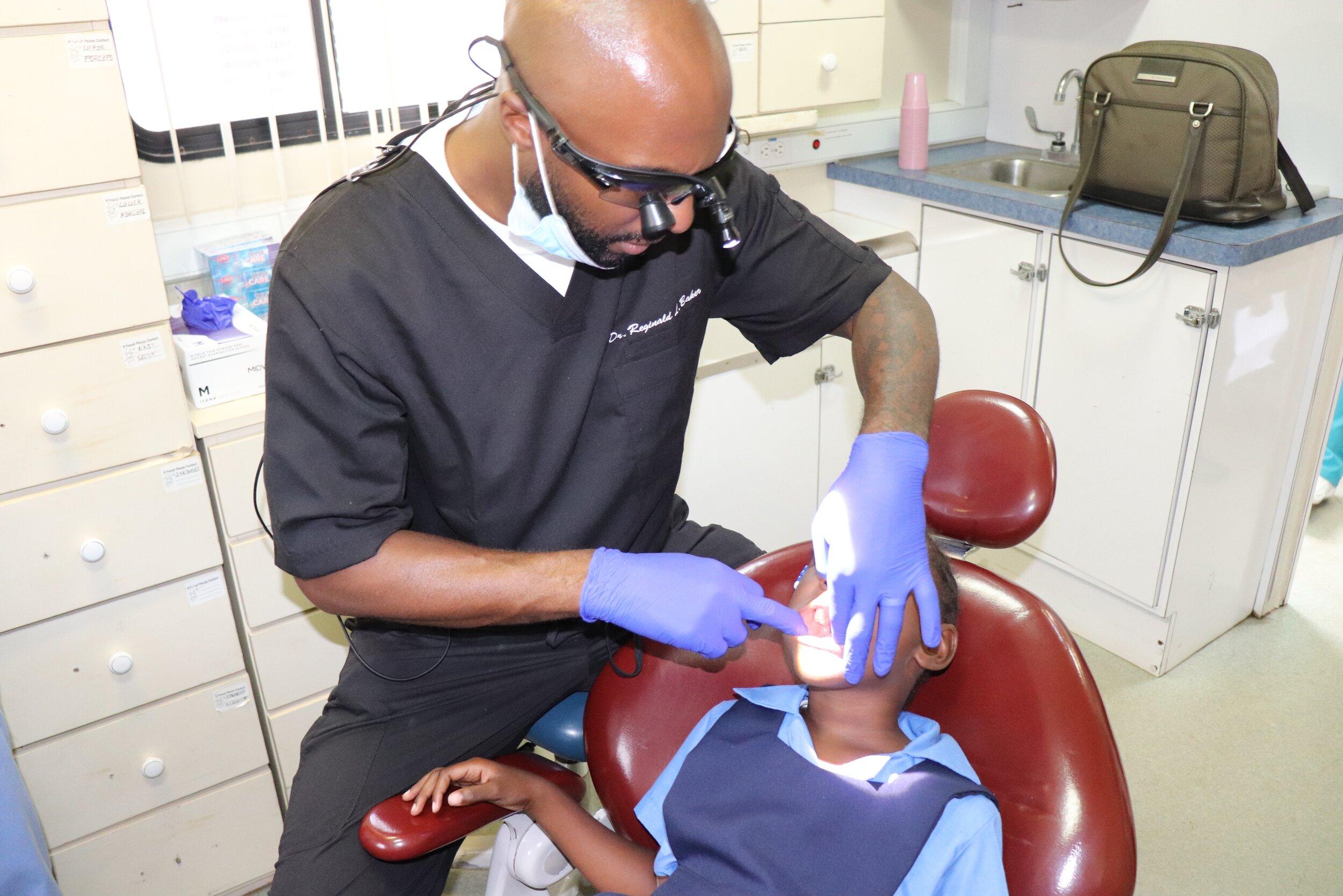 Dr. Baker performing examination