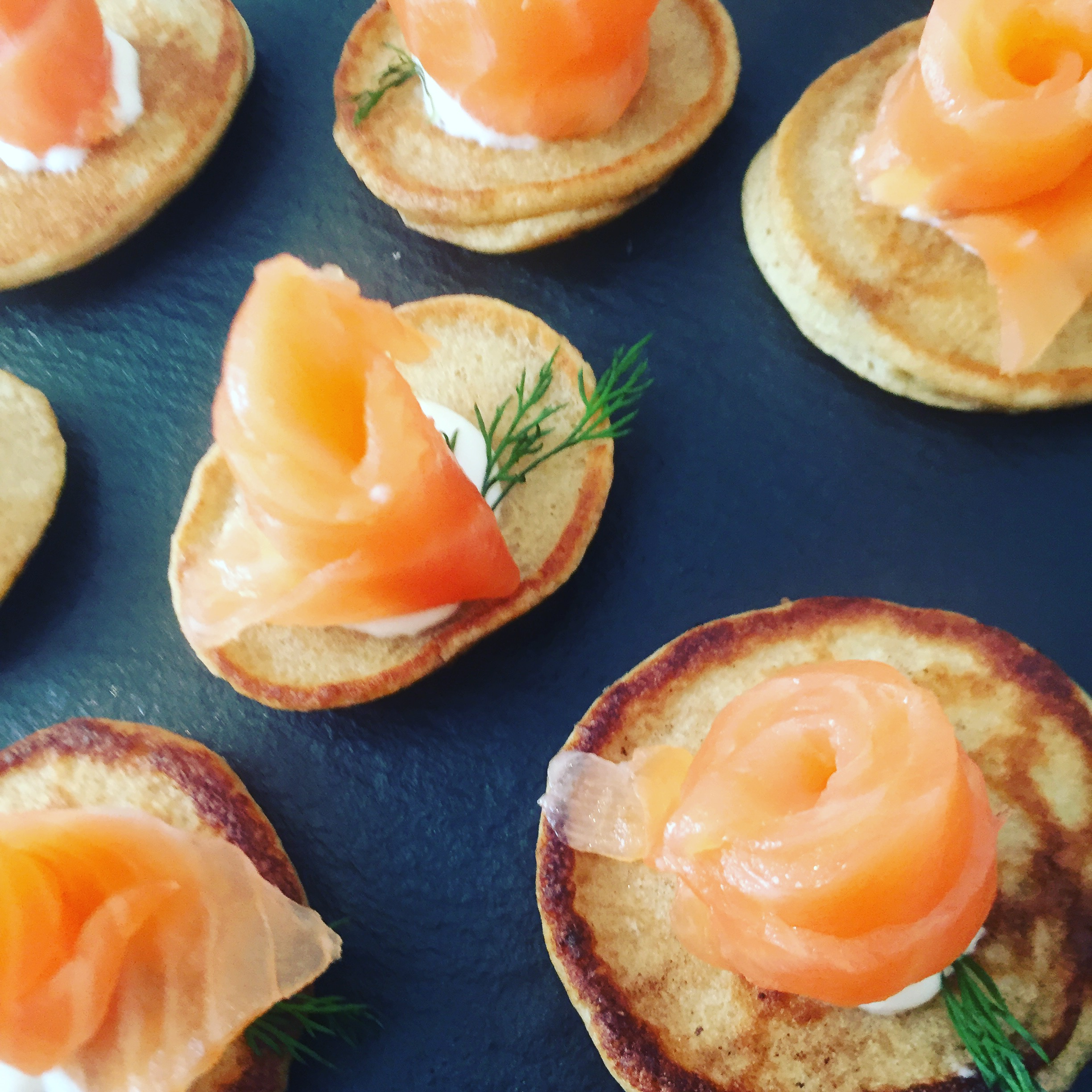 """This most excellent canapé..."": Smoked Salmon Roses, Caraway Blinis, Horseradish Crème Fraîche, Dill"
