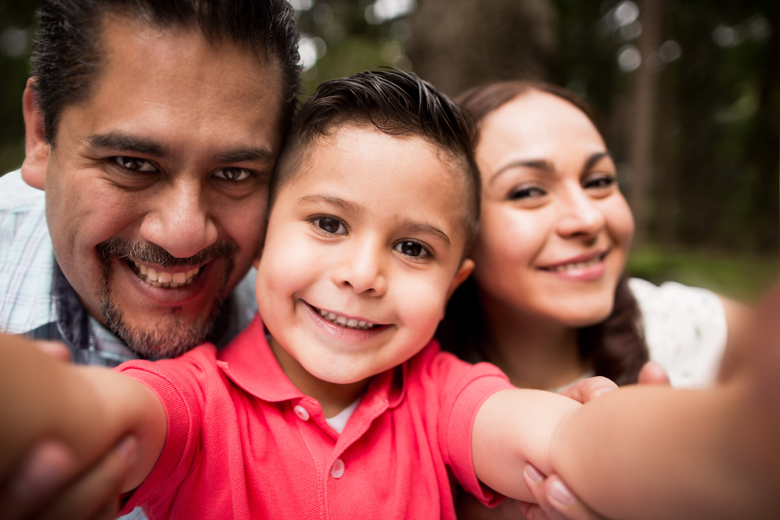 Latin-family-taking-a-selfie-and-smiling-at-camera-616887630_5760x3840.jpeg