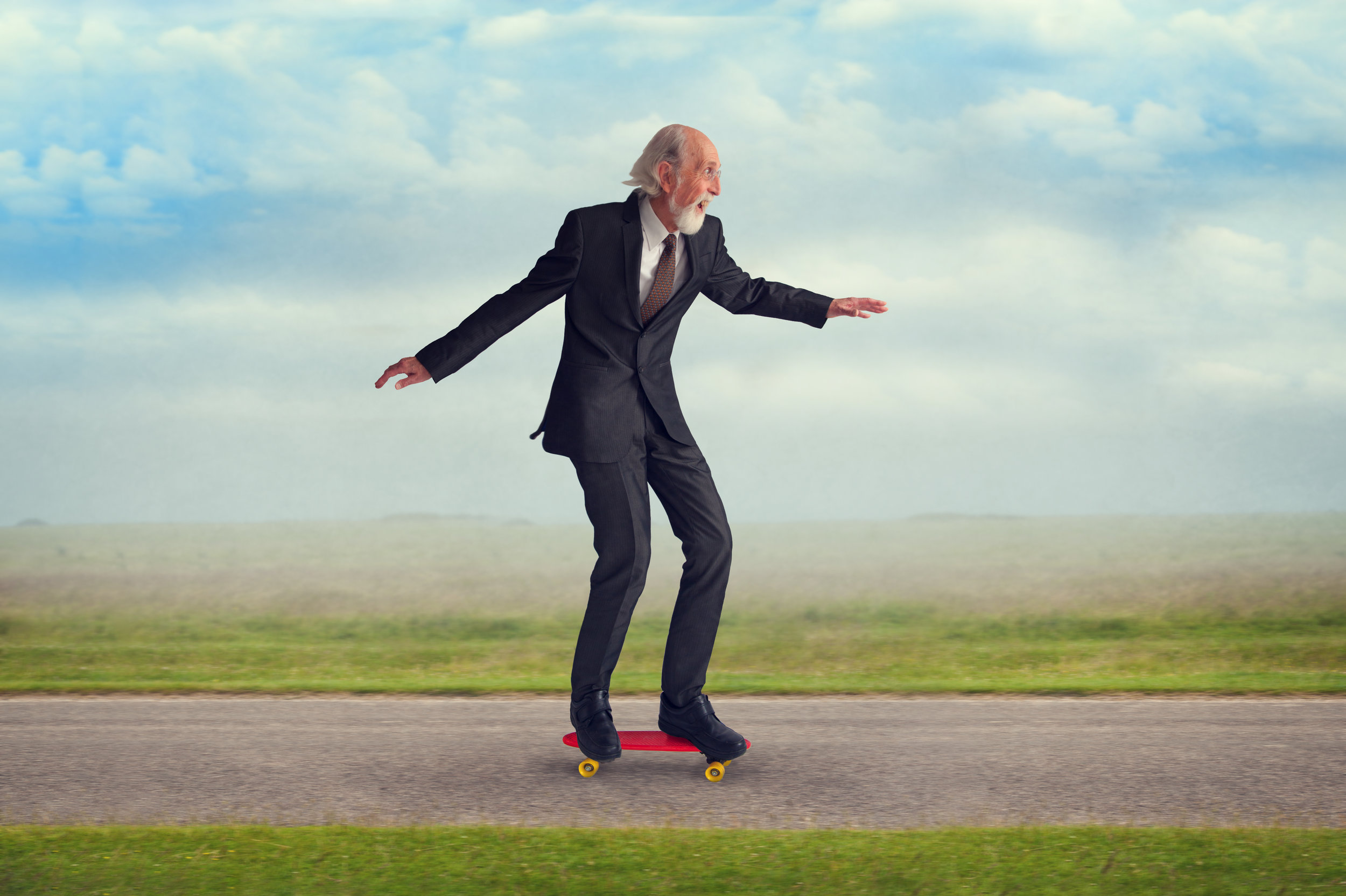 039914277-senior-man-riding-skateboard.jpeg