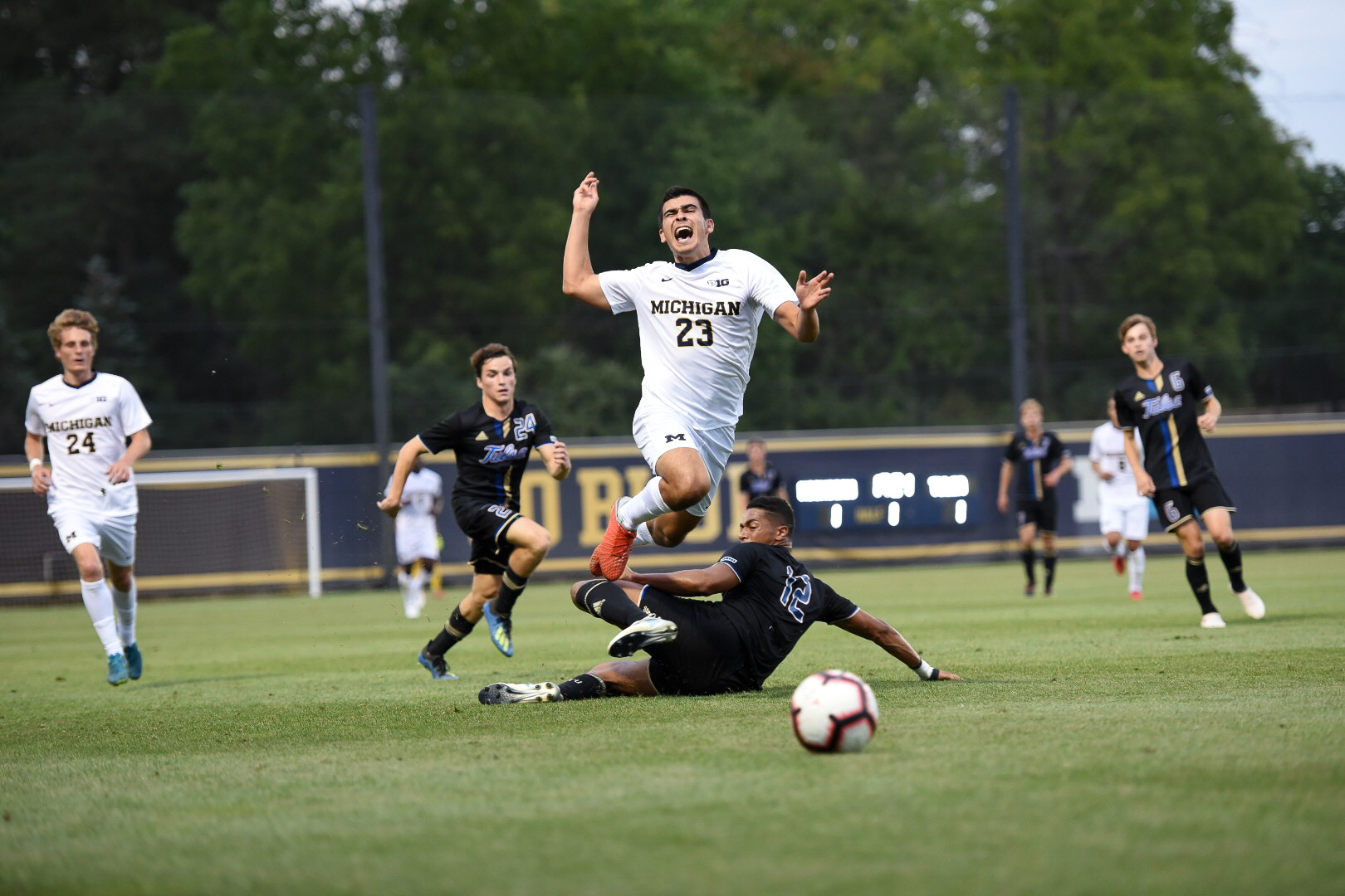 Marc Ybarra (23) is tackled during Michigan's 2-1 loss to Tulsa on Friday