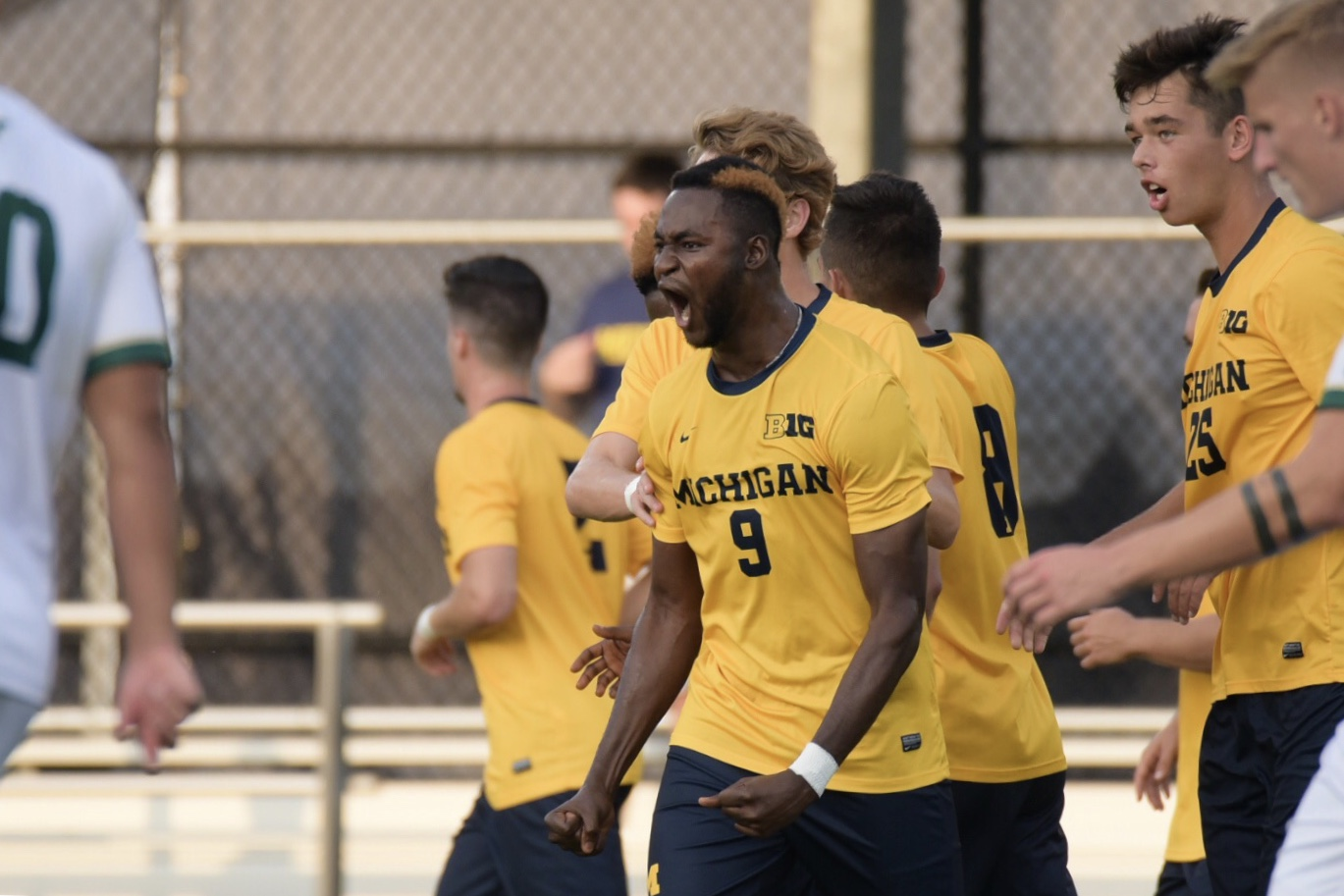 Mohammed Zakyi (#9) celebrates his free kick goal in Michigan's 2-0 win against South Florida.
