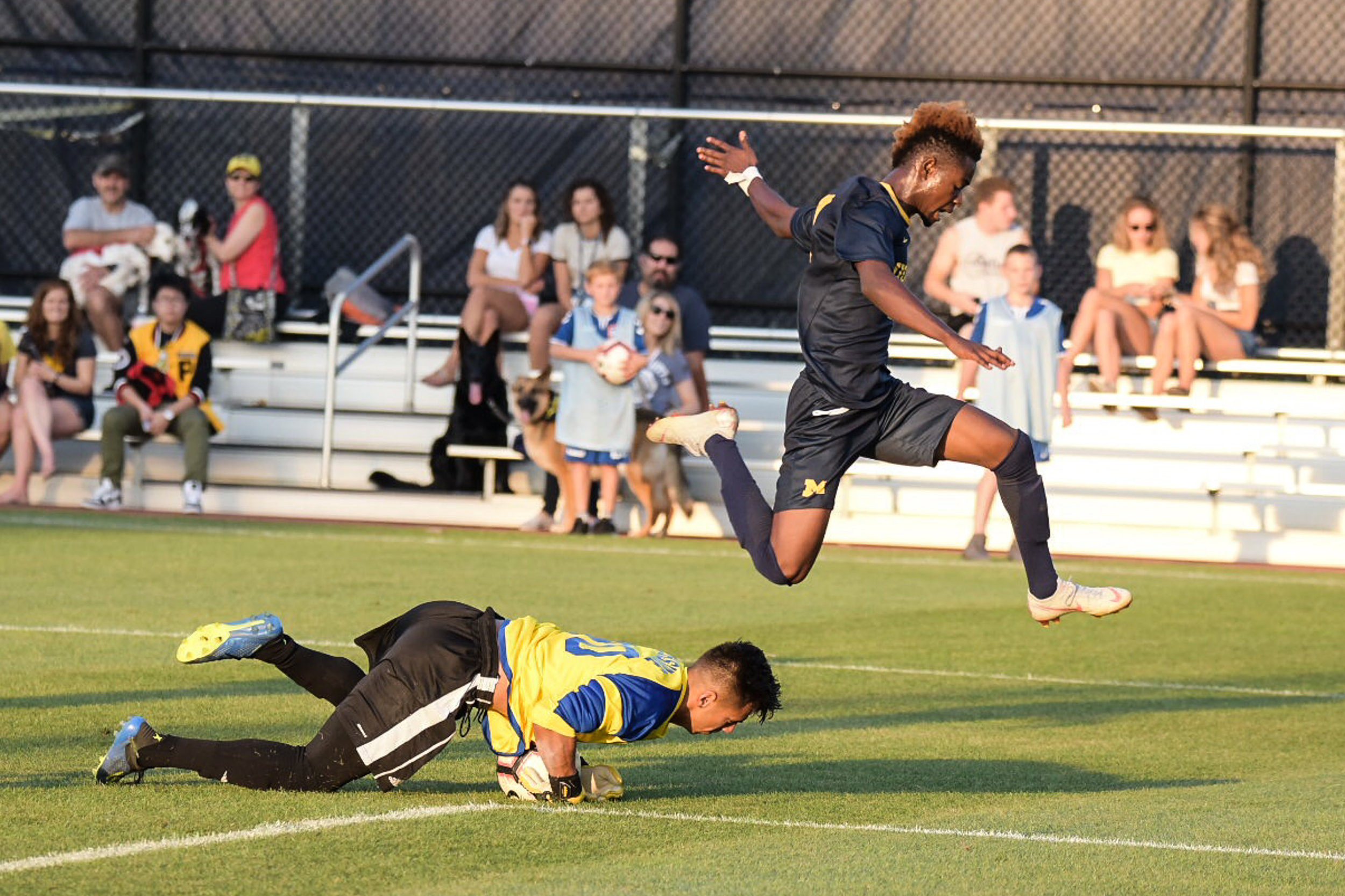 Umar Farouk Osman (#10) jumps over UCR's keeper