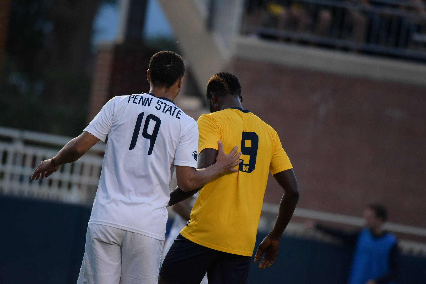 Mohammed Zakyi, Michigan's number nine, is marked by Ryan Gallagher in these two sides' first meeting.