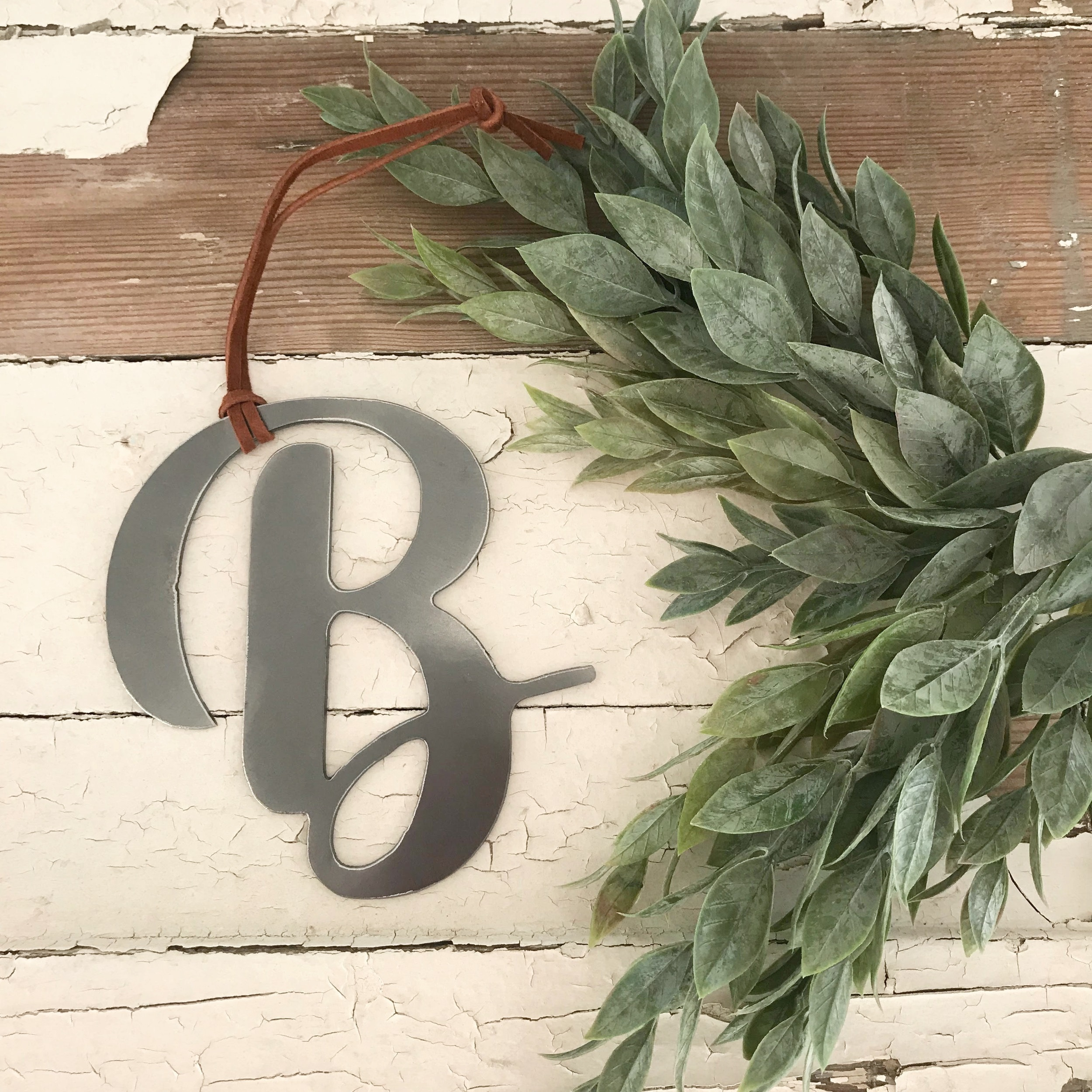 New,  simplified monogram ornaments . Use one initial for each stocking tag, or simply get your family monogram for your tree.