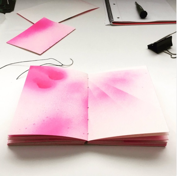 Hand-bound art journal with hand-sprayed pages.