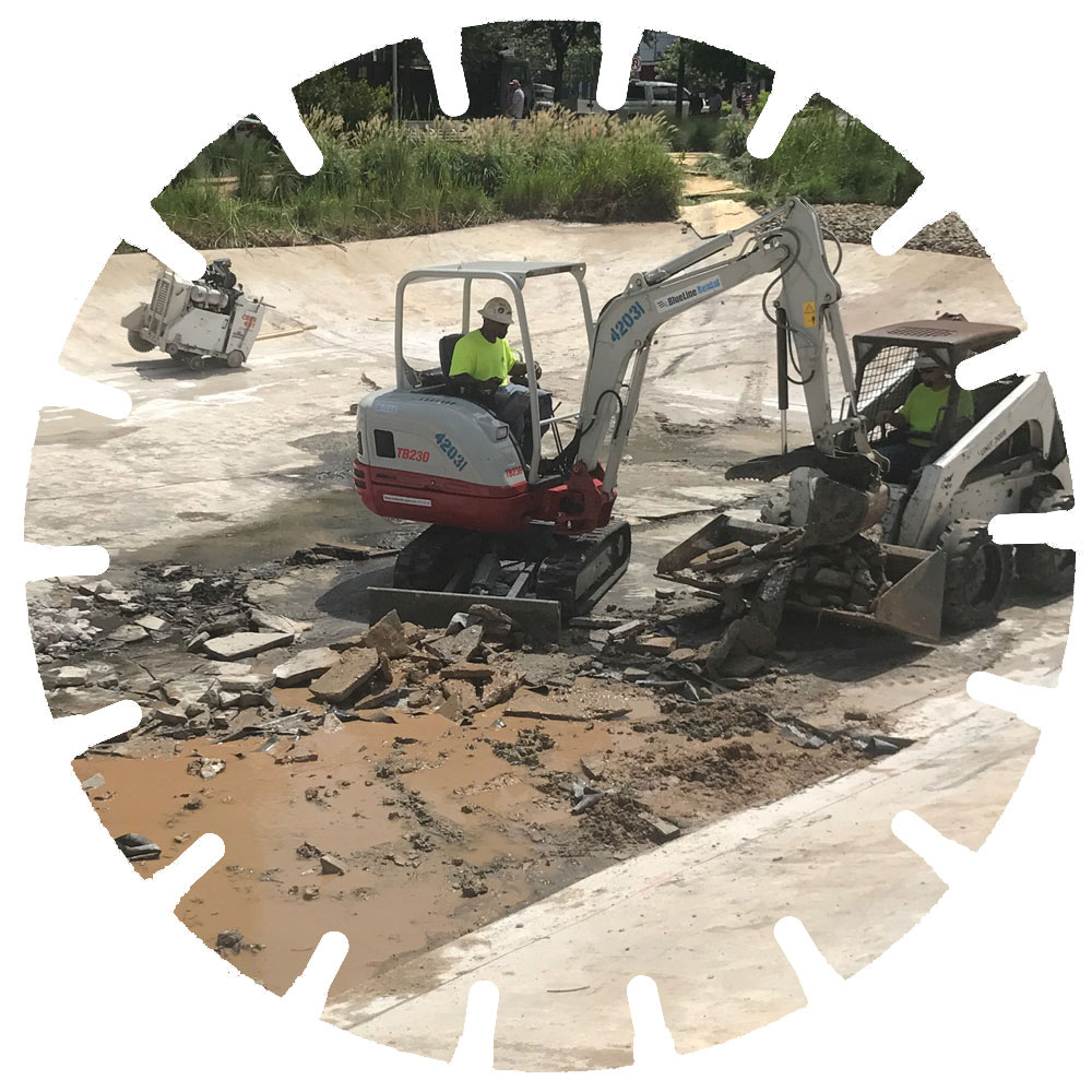 Concrete Breaking & Removal - No concrete is too thick for our demolition crews. We'll break and remove the concrete and dirt on your job site.